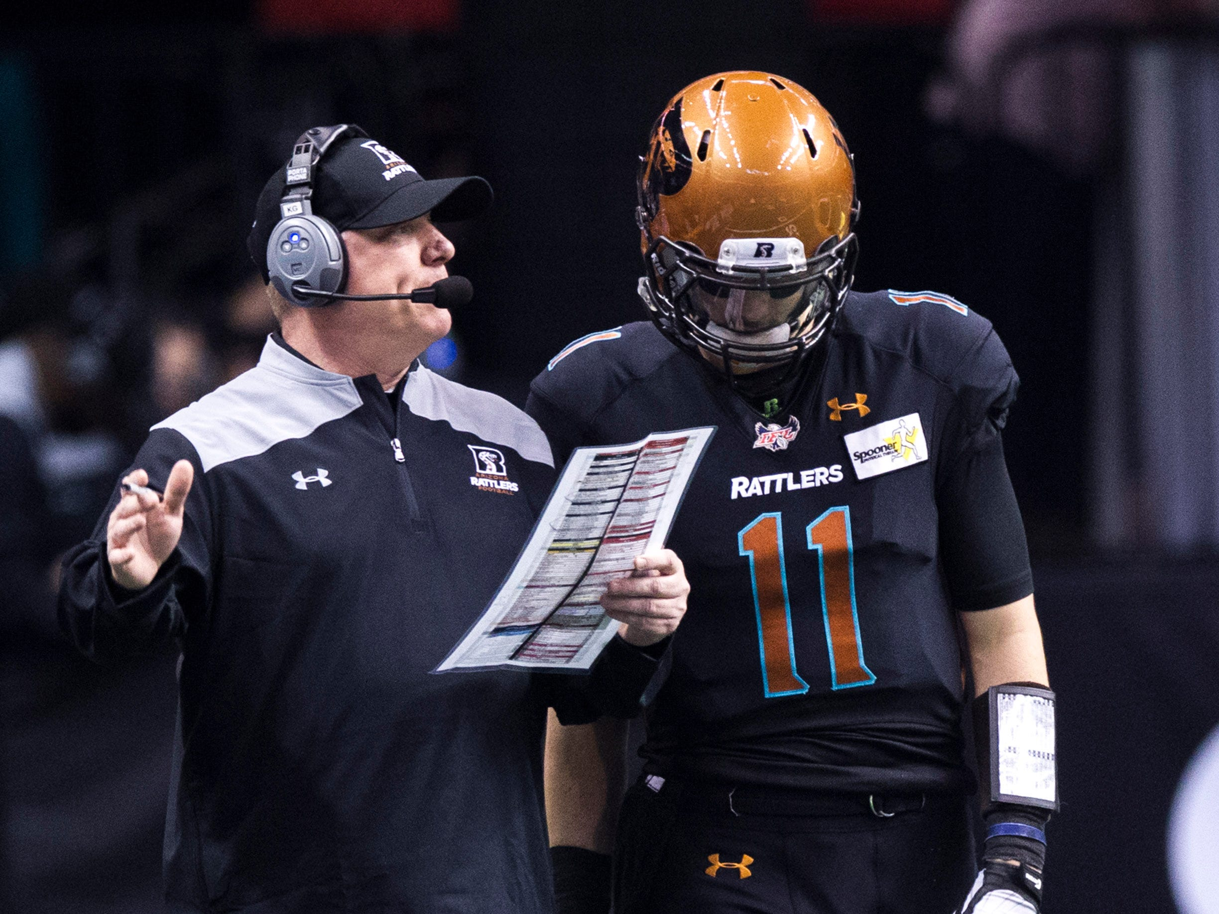 Arizona Rattlers' head coach Kevin Guy talks to his quarterback Jeff Ziembe during the first half of their game against the San Diego Strike Force at Talking Stick Resort Arena in Phoenix Friday, April. 6, 2019.