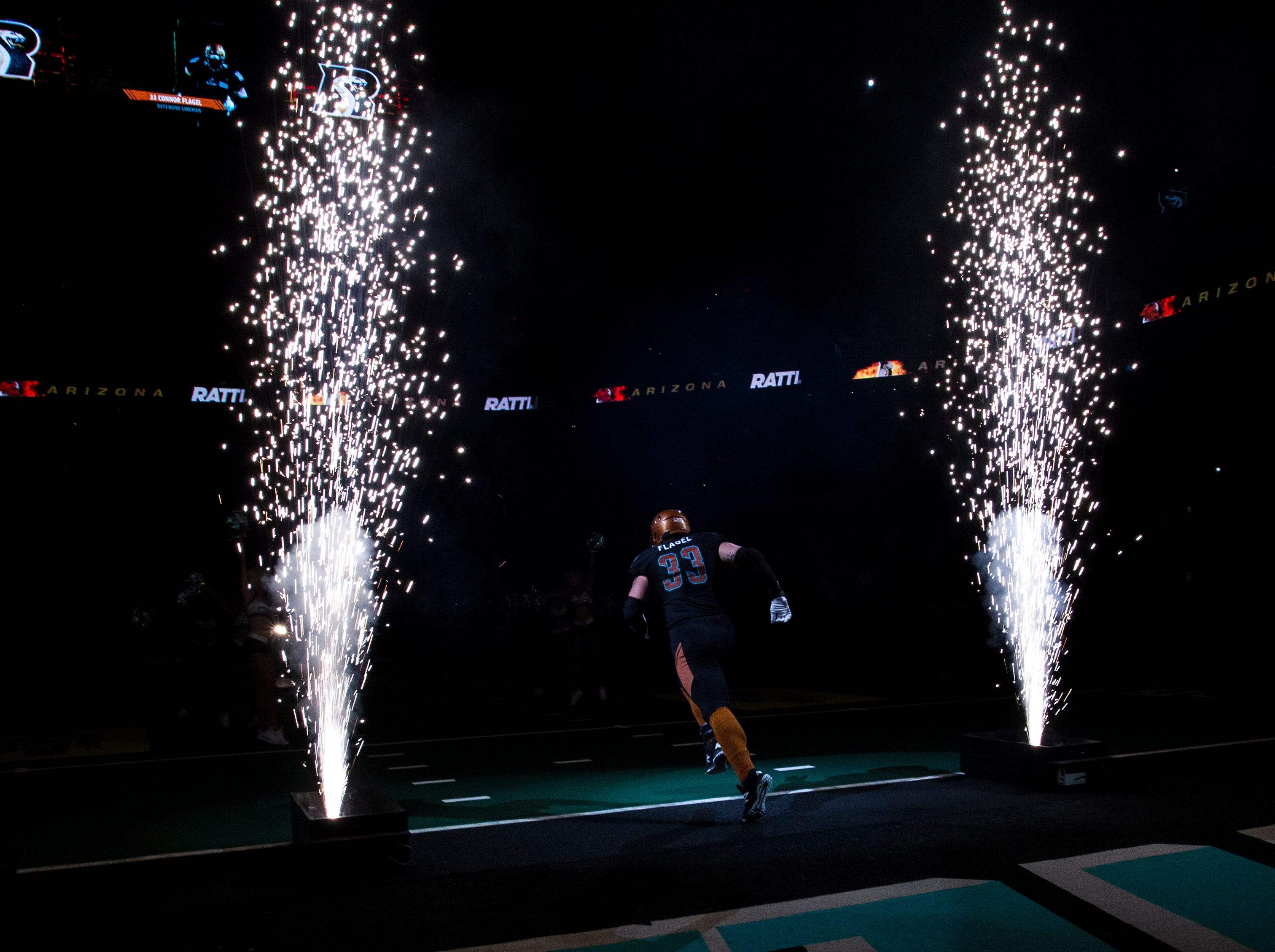 Arizona Rattlers' Connor Flagel (33) runs out onto the field before their game with San Diego Strike Force at Talking Stick Resort Arena in Phoenix Friday, April. 6, 2019.