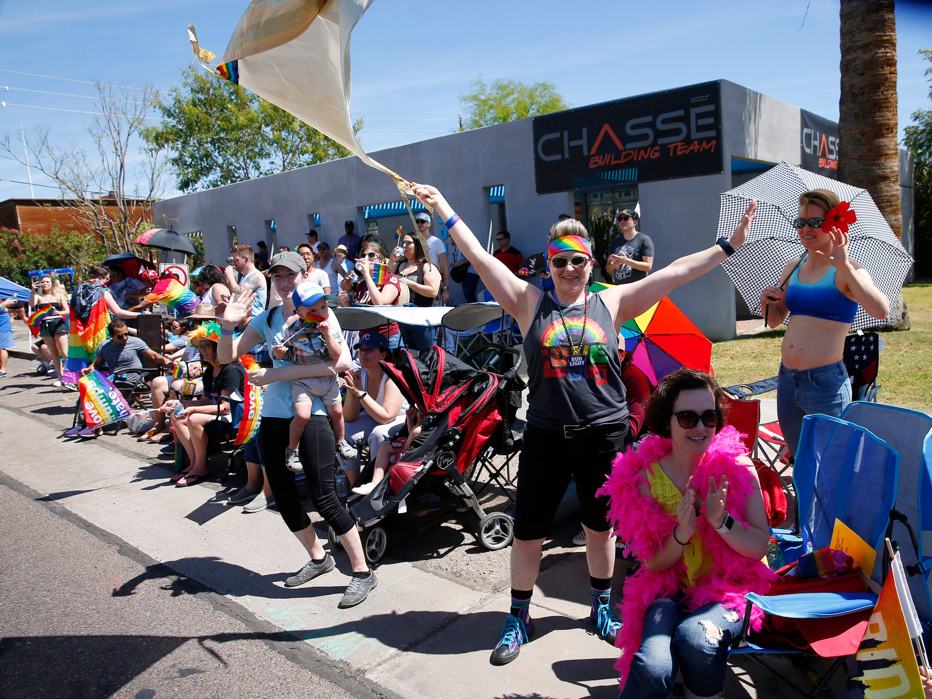 Spectators cheer during the Phoenix Pride Parade on April 7, 2019.