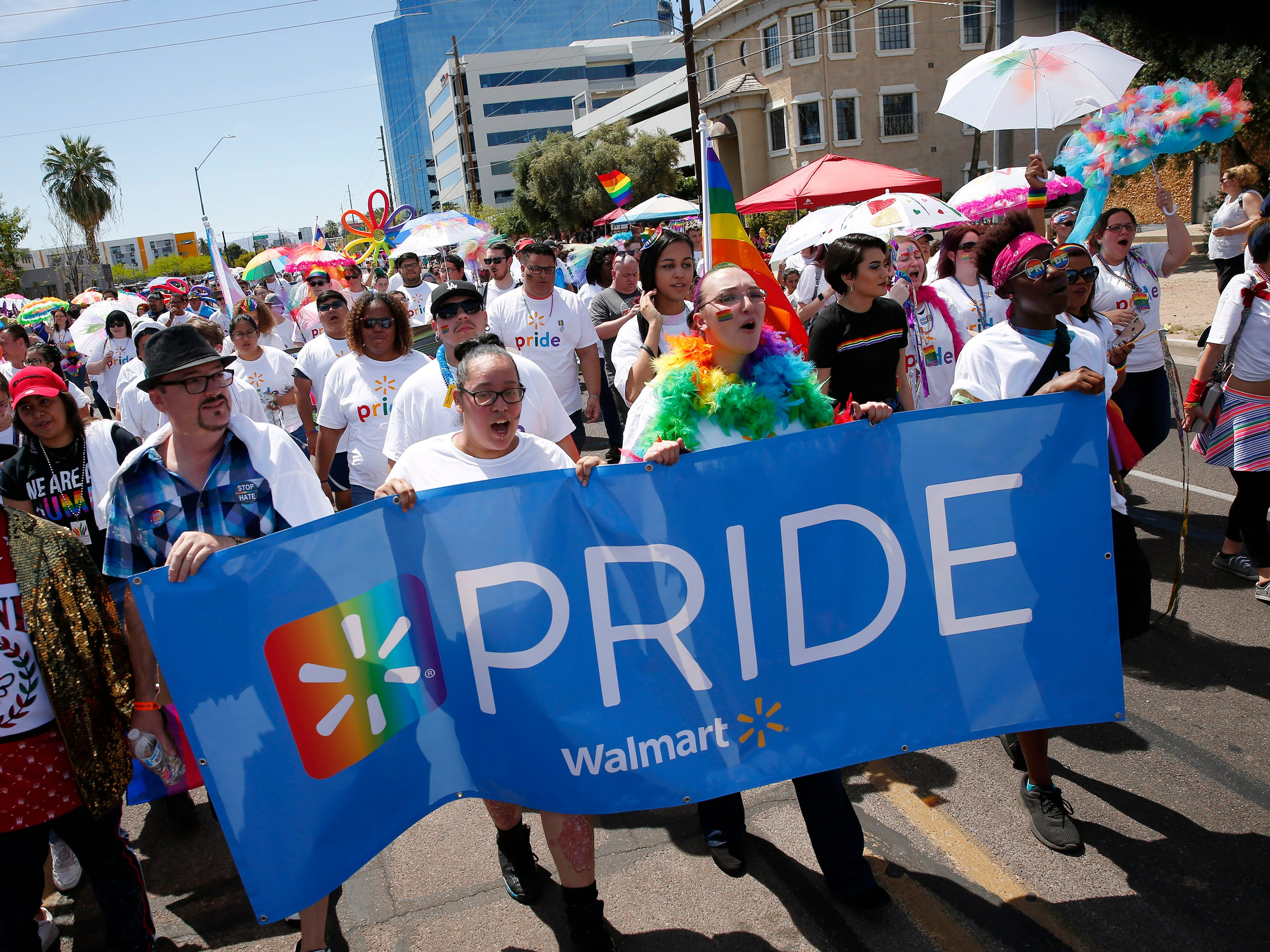 Participants with Walmart march during the Phoenix Pride Parade on April 7, 2019.