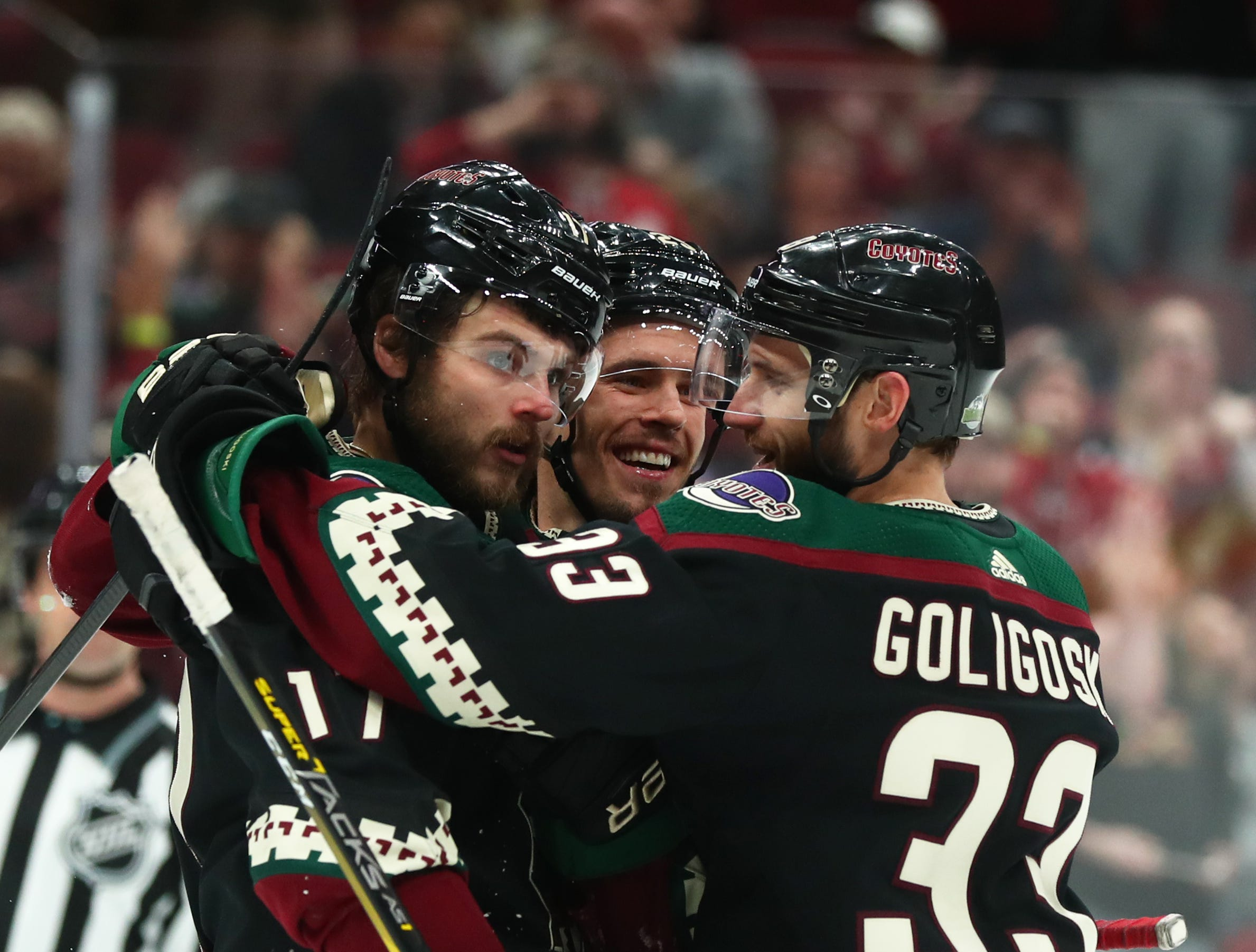 Apr 6, 2019; Glendale, AZ, USA; Arizona Coyotes center Alex Galchenyuk (17), Nick Cousins (25) and Alex Goligoski (33) celebrate a goal against the Winnipeg Jets in the first period at Gila River Arena. Mandatory Credit: Mark J. Rebilas-USA TODAY Sports