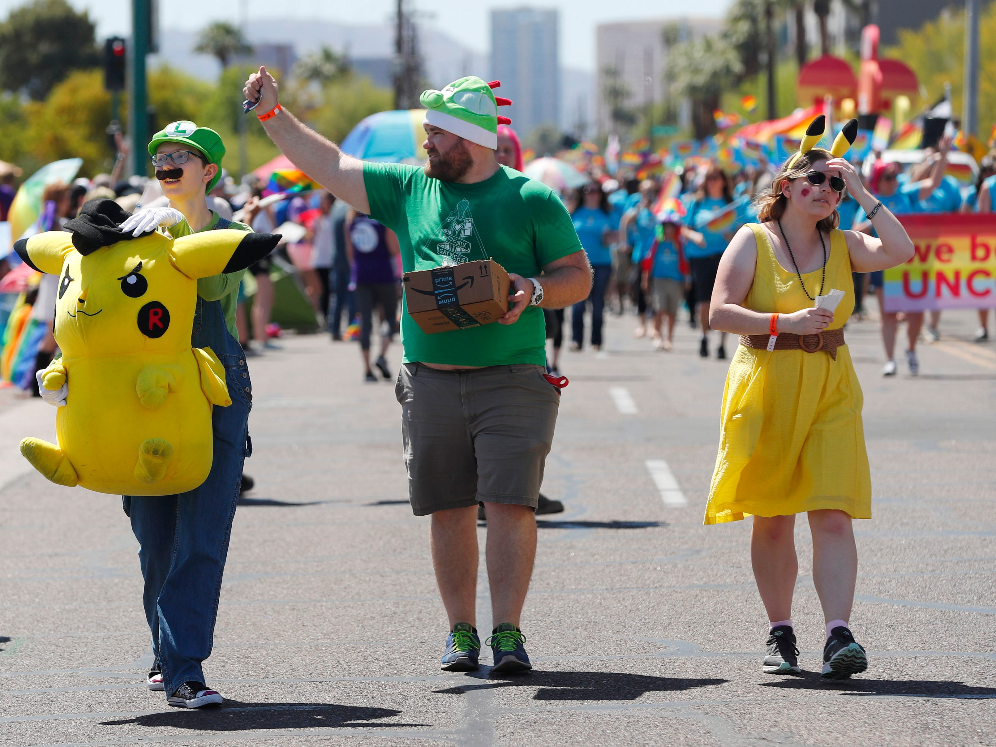 Participants with Phoenix Gaymers march during the Phoenix Pride Parade on April 7, 2019.