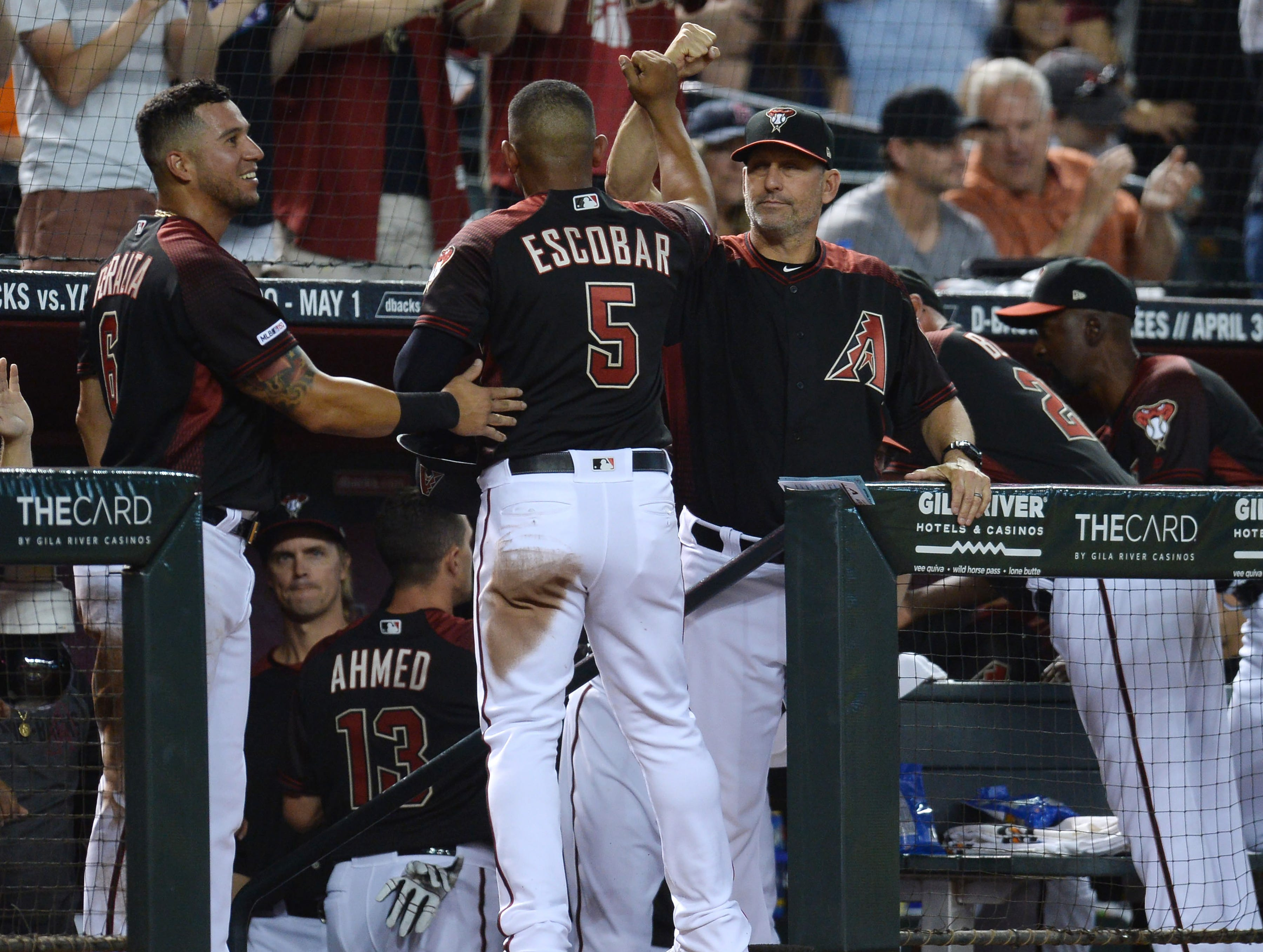 Apr 6, 2019; Phoenix, AZ, USA; Arizona Diamondbacks third baseman Eduardo Escobar (5) celebrates with Arizona Diamondbacks manager Torey Lovullo (17) after scoring a run against the Boston Red Sox during the second inning at Chase Field. Mandatory Credit: Joe Camporeale-USA TODAY Sports