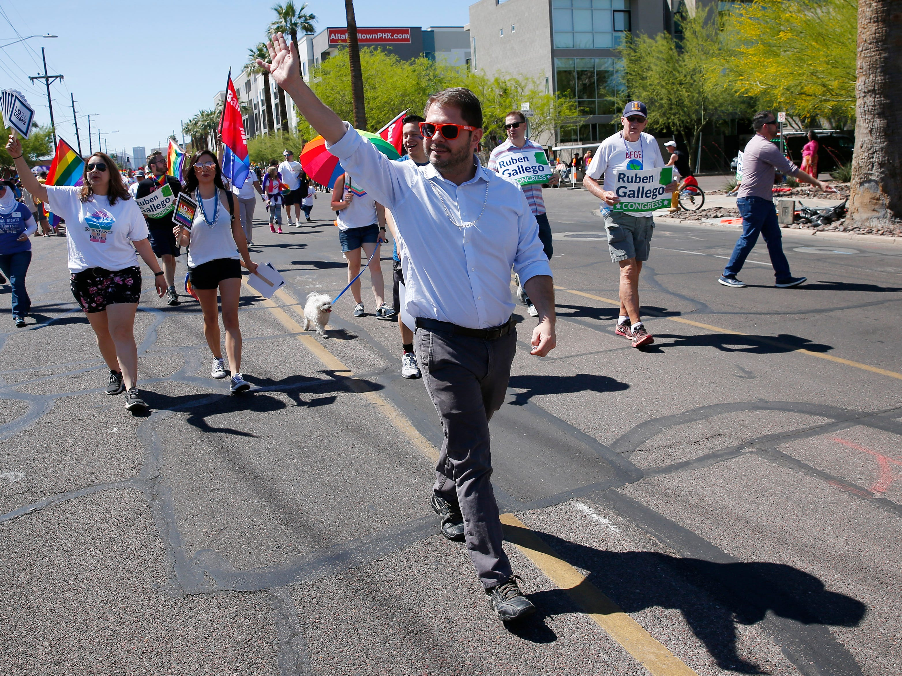Congressman Ruben Gallego waves during the Phoenix Pride Parade on April 7, 2019.