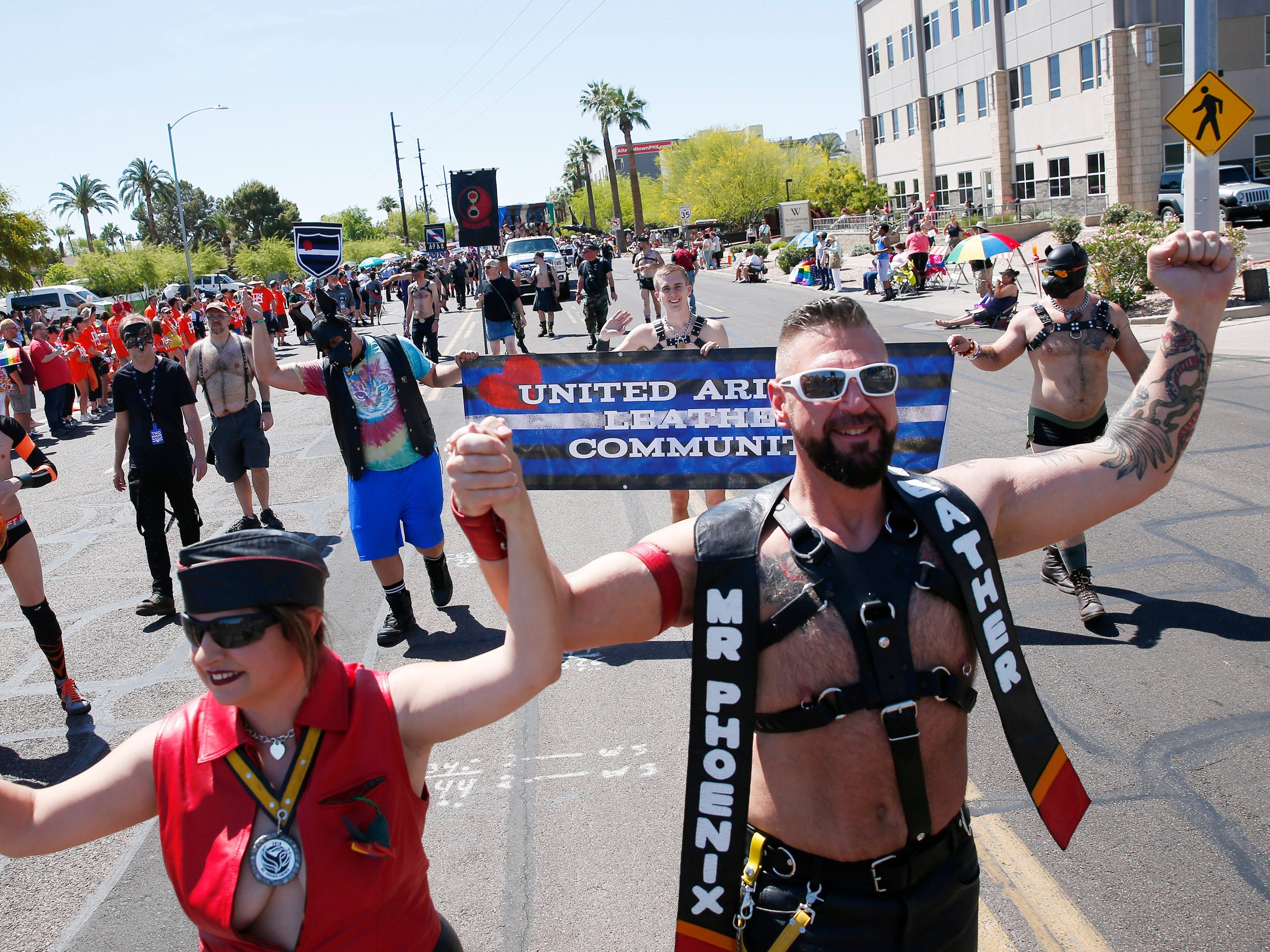 Participants with United Arizona Leather Community march during the Phoenix Pride Parade on April 7, 2019.