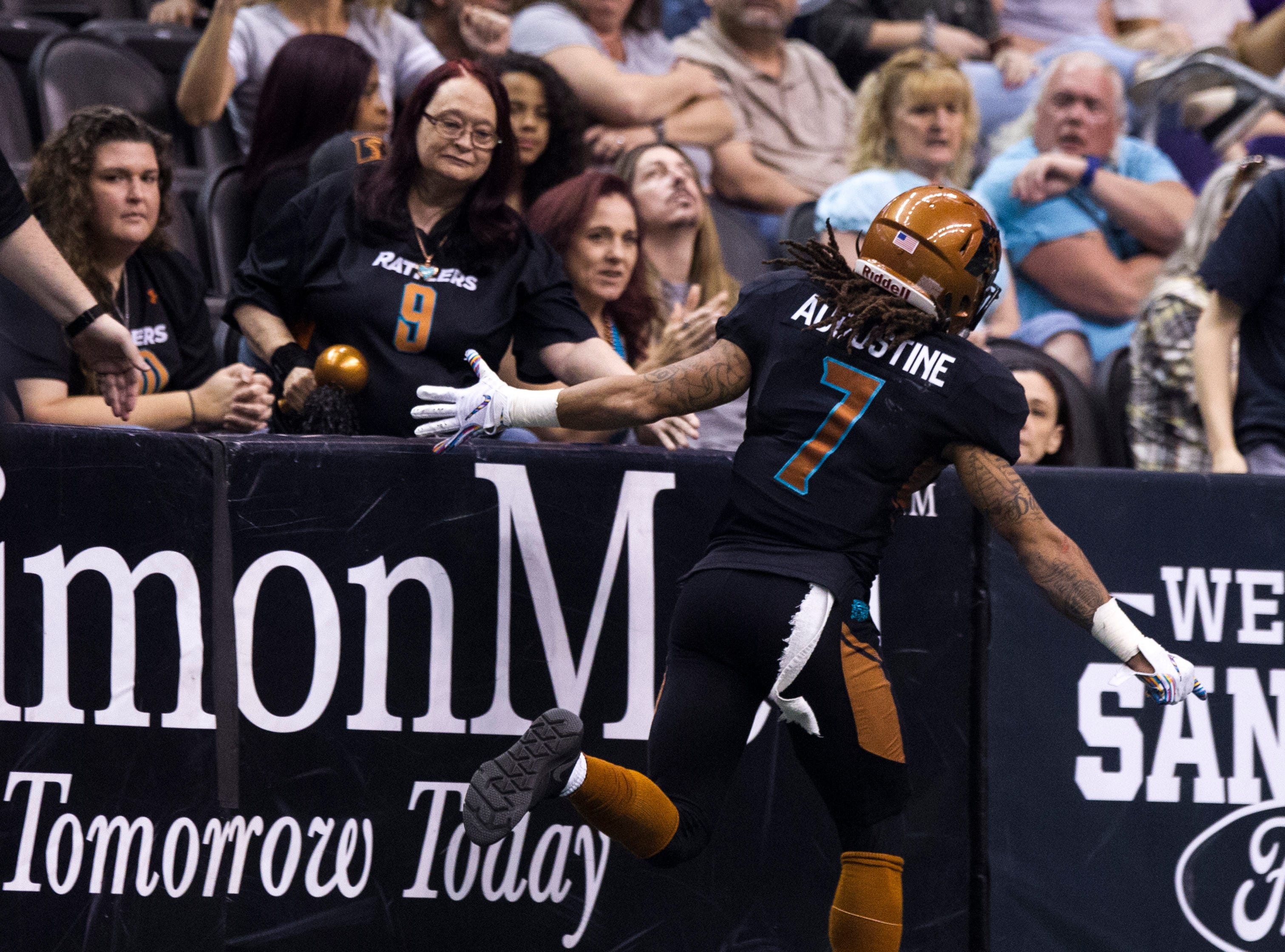 Arizona Rattlers' Sheldon Augustine (7) high five fans after scoring a touchdown against the San Diego Strike Force during the second half of their game at Talking Stick Resort Arena in Phoenix Friday, April. 6, 2019.
