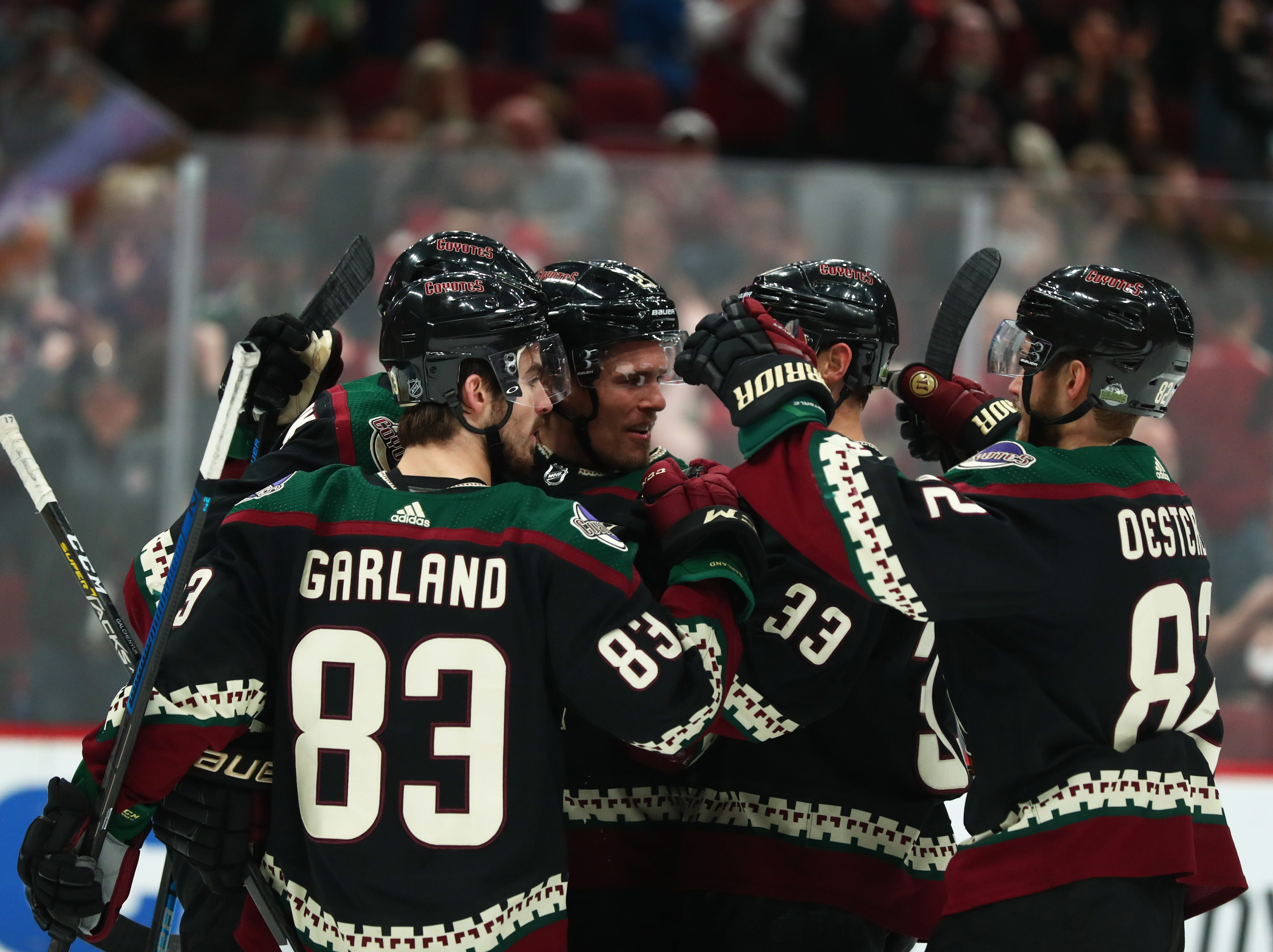Apr 6, 2019; Glendale, AZ, USA; Arizona Coyotes players congratulate center Alex Galchenyuk after scoring a goal against the Winnipeg Jets in the first period at Gila River Arena. Mandatory Credit: Mark J. Rebilas-USA TODAY Sports