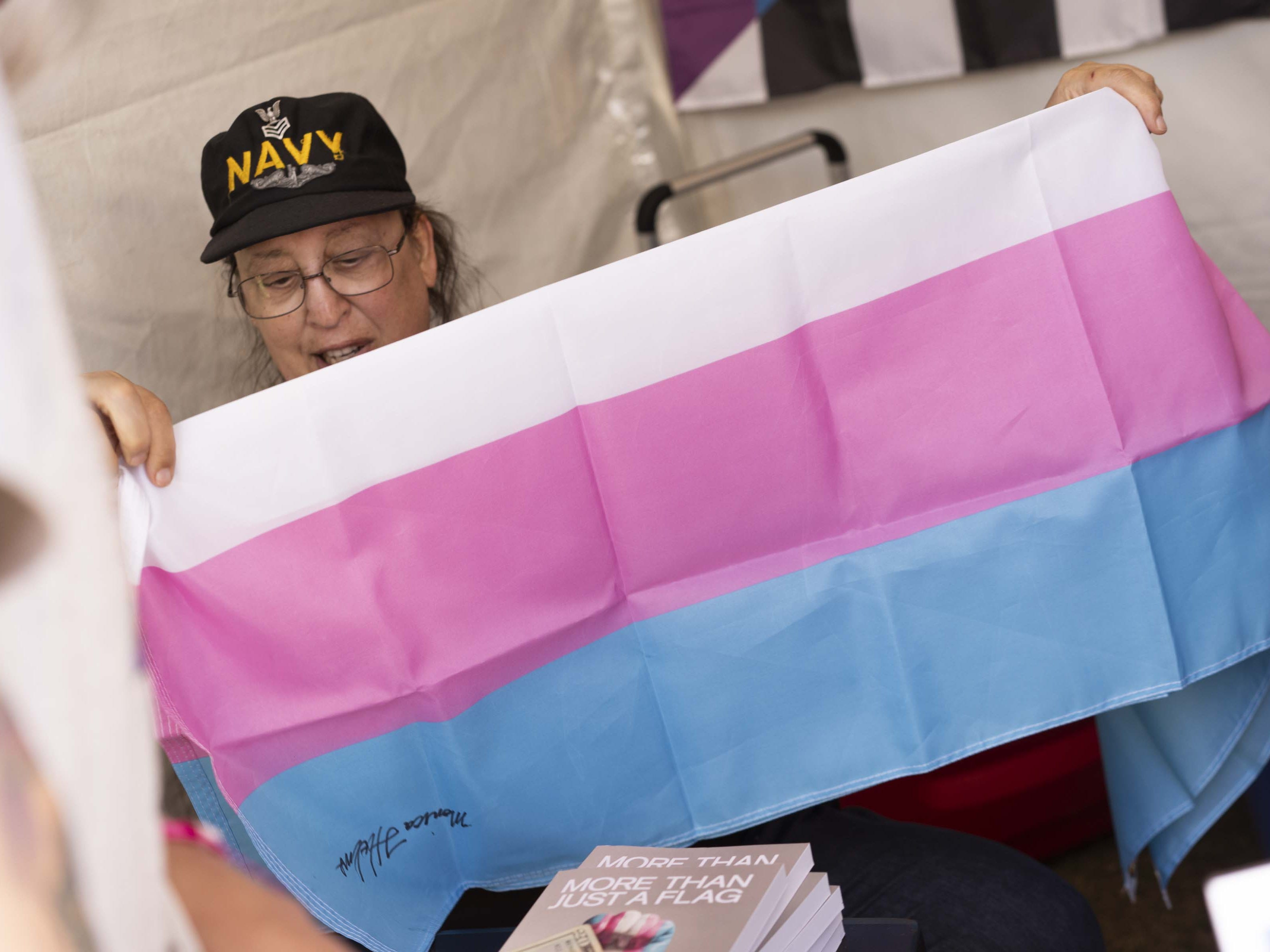 Monica Helms, who created transgender pride flag, signs a books for fans during Phoenix Pride at Steele Indian School Park on April 6, 2019.