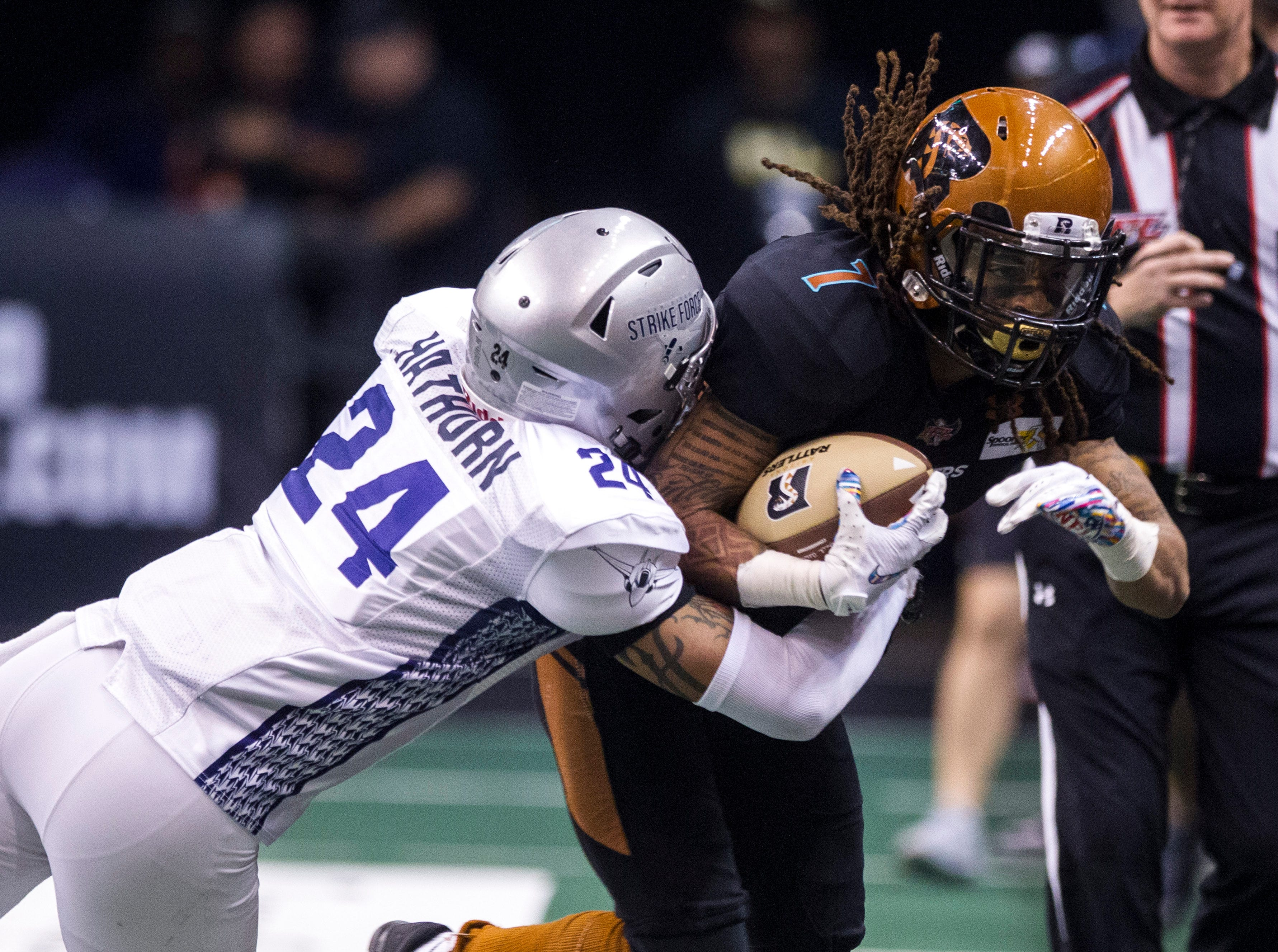 Arizona Rattlers' Sheldon Augustine (7) gets knocked into the boards by San Diego Strike Force's Deshawn Hathorn (24) during the second half of their game at Talking Stick Resort Arena in Phoenix Friday, April. 6, 2019.