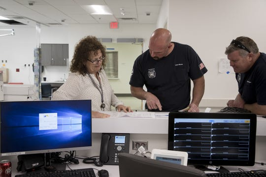 Barb Bovee (left) Phoenix firefighters a tour of the Emergency Department at the Maricopa Integrated Health System Maryvale campus on April 1, 2019.
