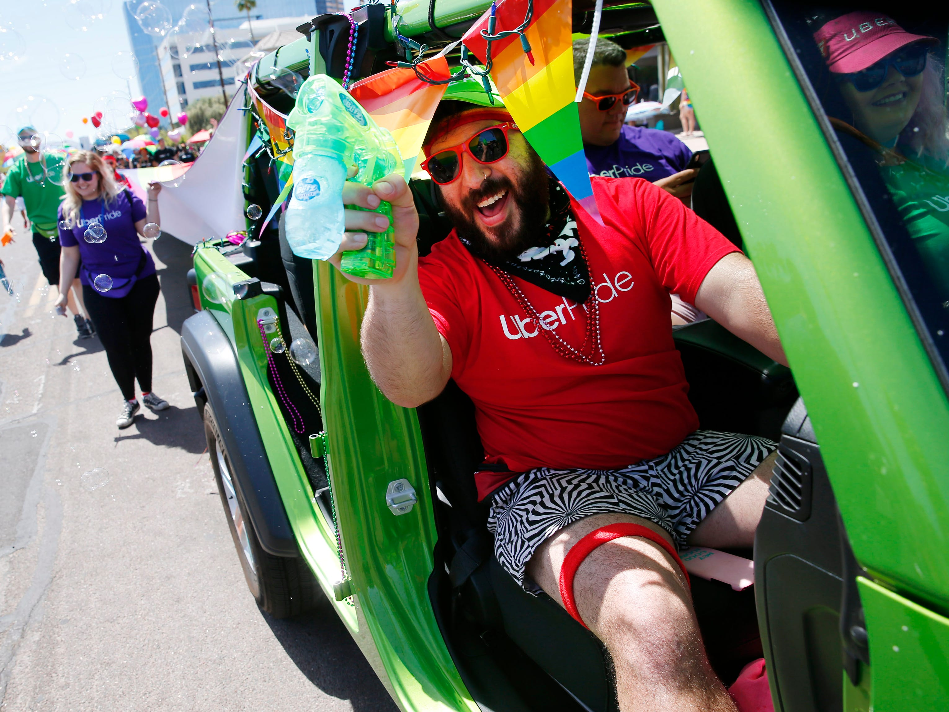 Participants with Uber march during the Phoenix Pride Parade on April 7, 2019.