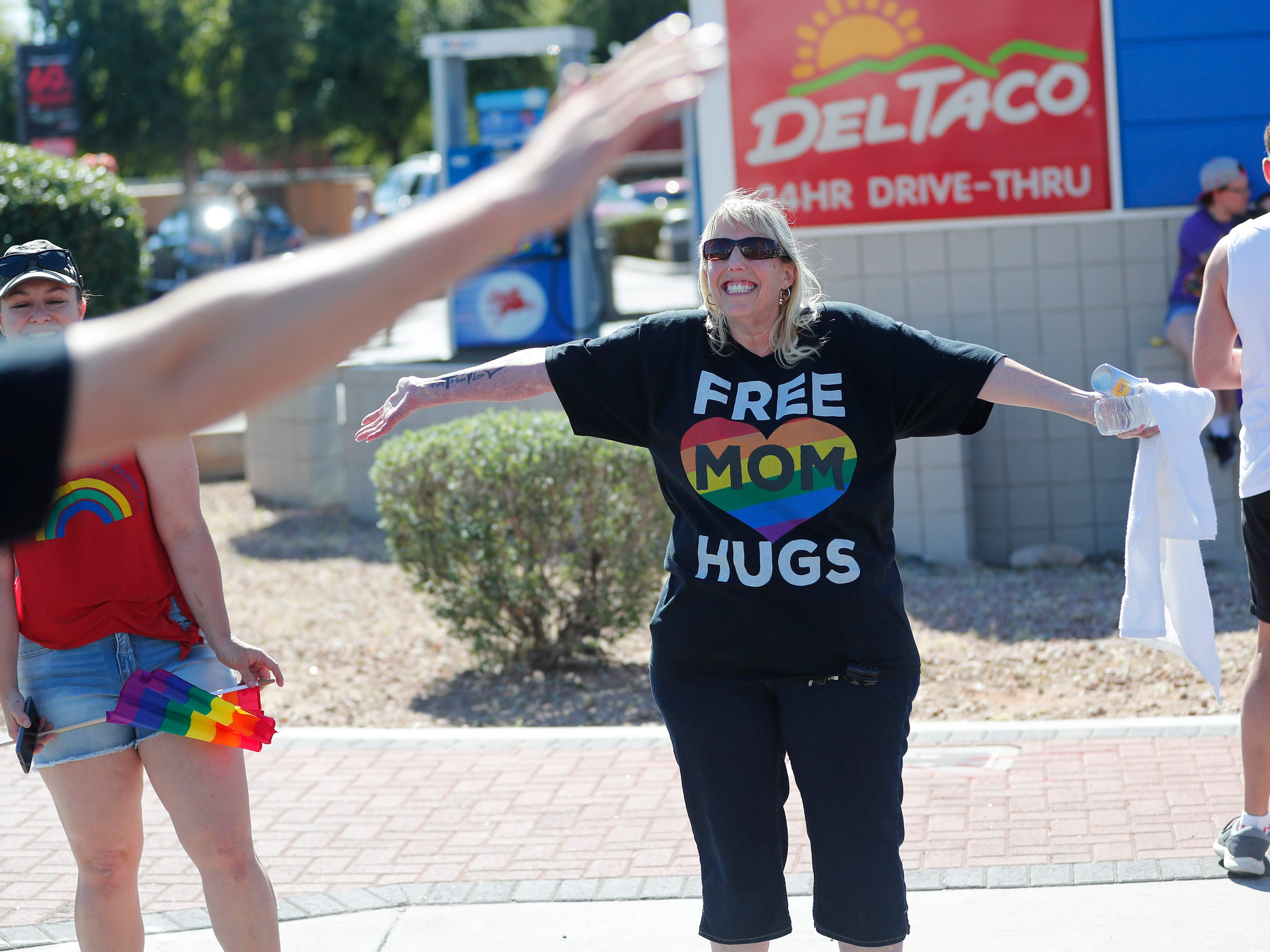 Wendy Esquivel gives hugs during the Phoenix Pride Parade on April 7, 2019.