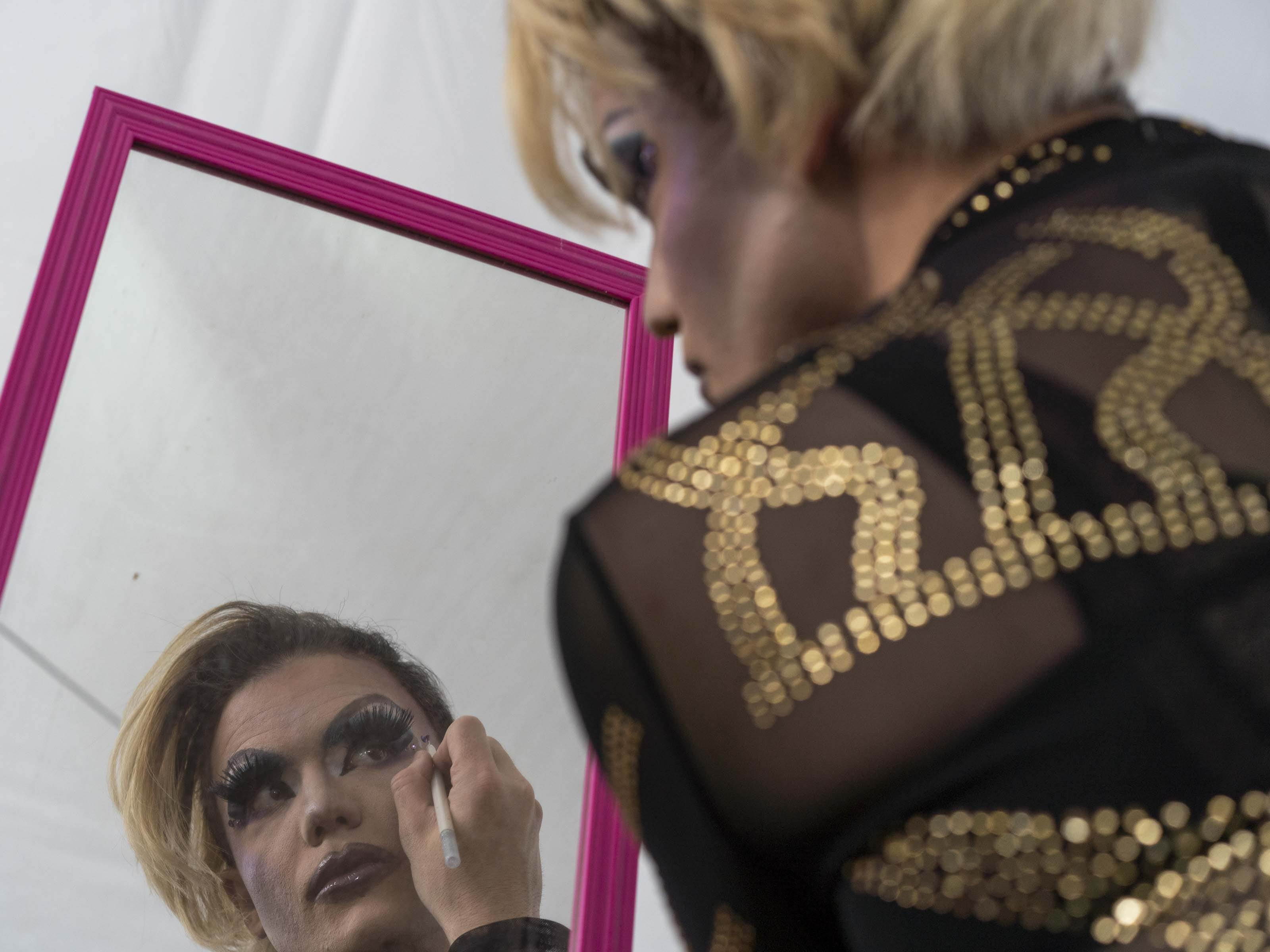 Penny Drynx gets ready to perform at the community stage during Phoenix Pride at Steele Indian School Park on Saturday, April 6, 2019.