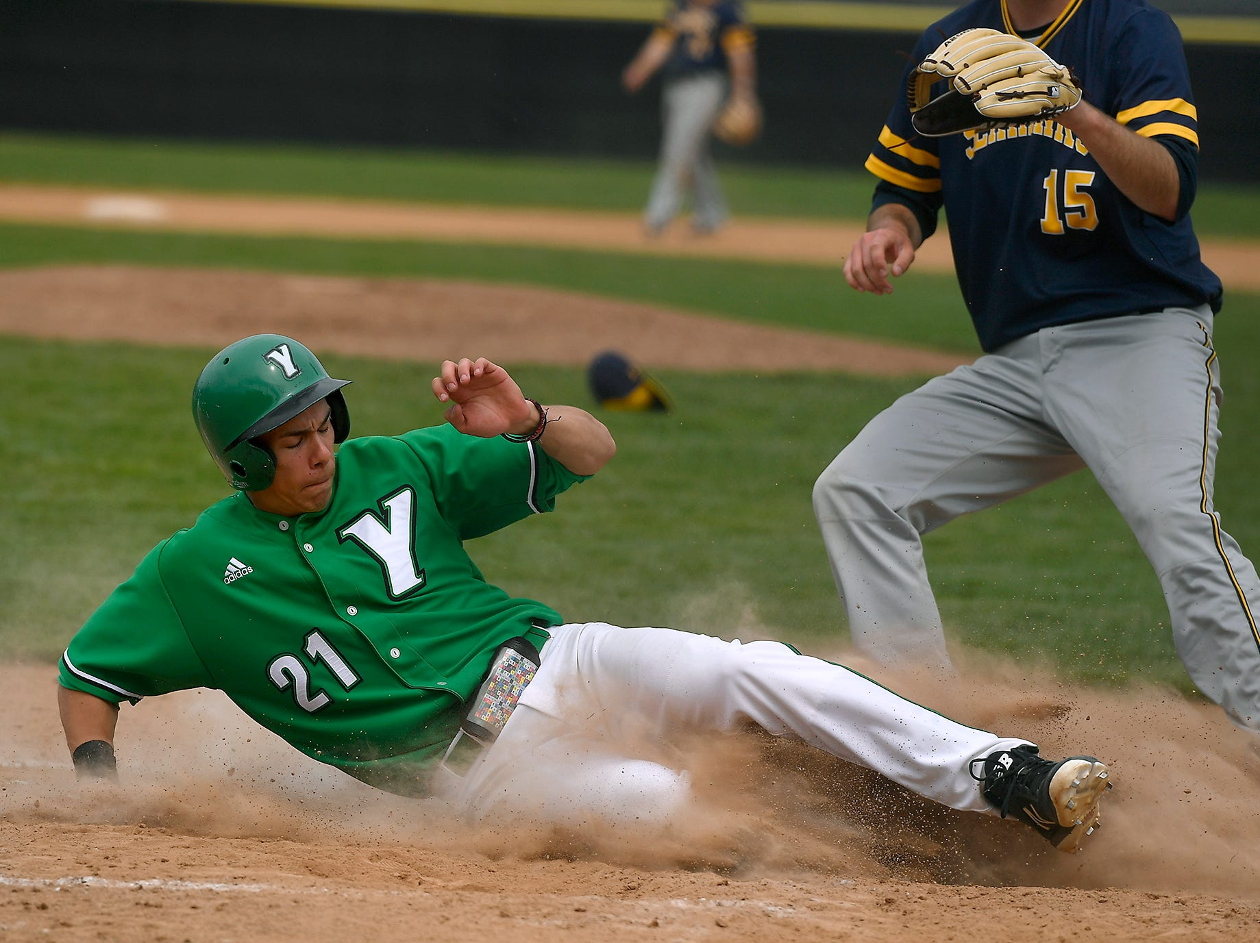 Jimmy Wiegers of York College slides into home, scoring against St. Mary's on a passed ball, Sunday, April 7, 2019.John A. Pavoncello photo