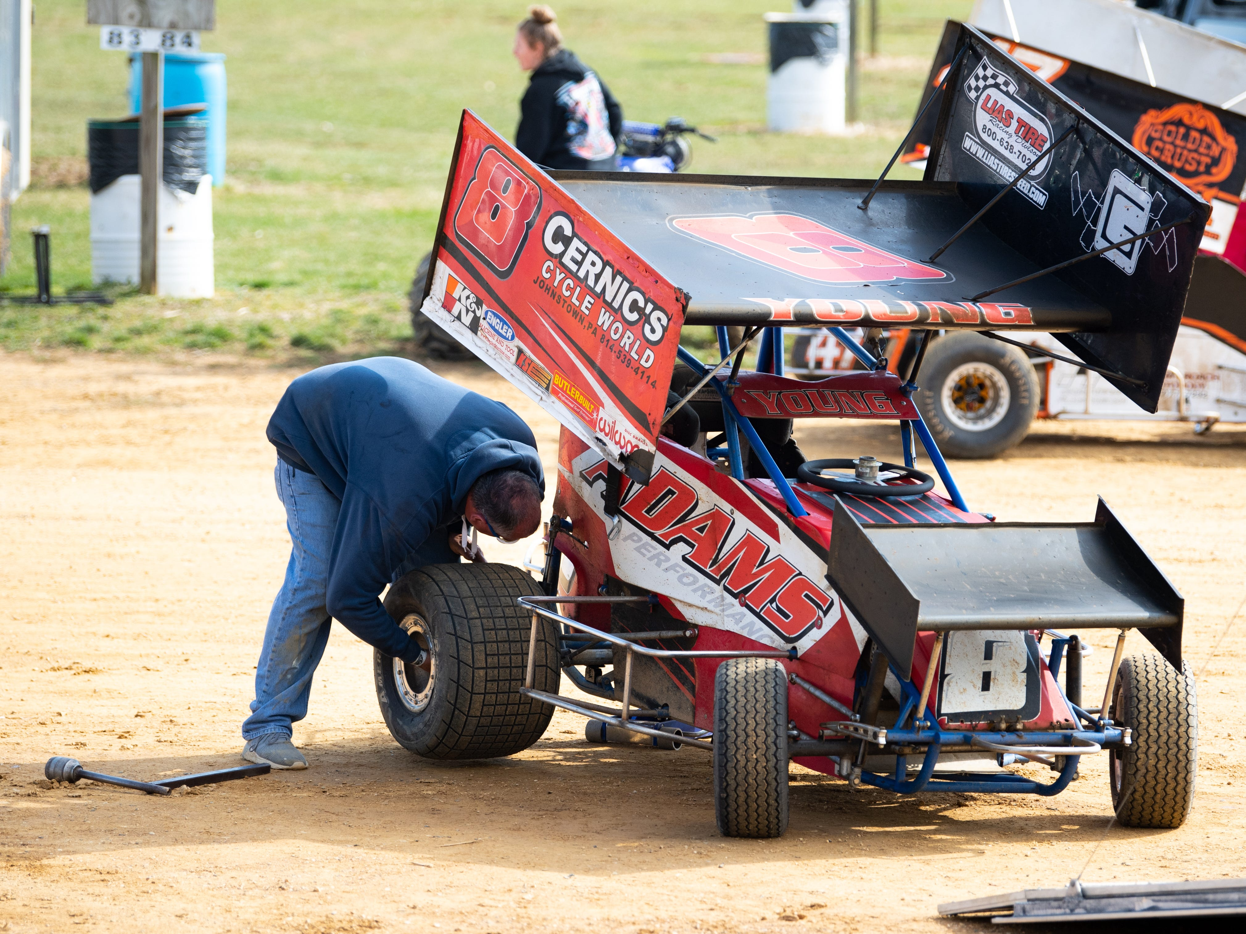 The tire on Jim Young's car #8, is changed during the Trail-Way Speedway season opener, April 6, 2019.