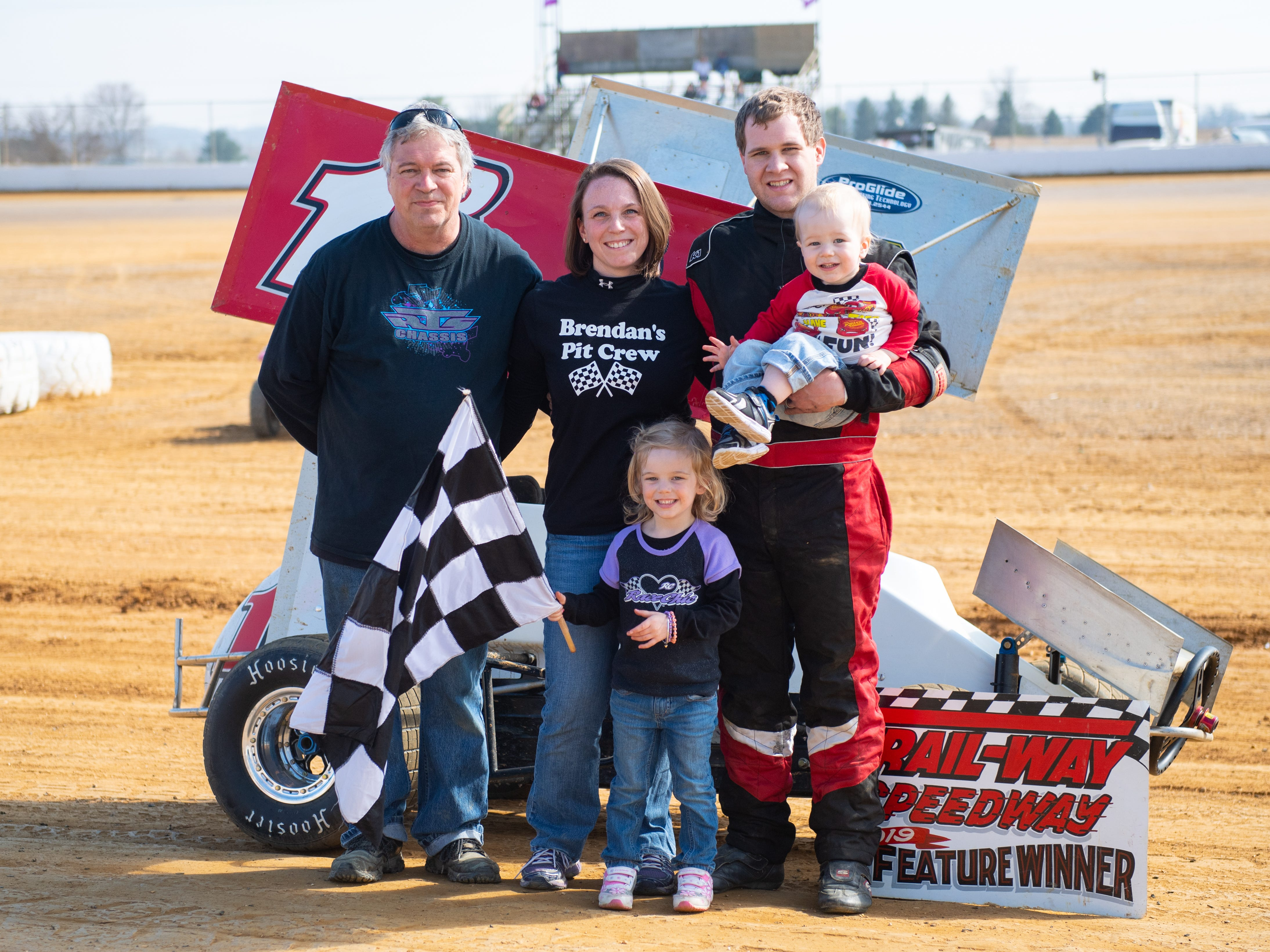 Brent Bull (1B) poses with his family after winning his heat in the 600 Micro Sprints during the Trail-Way Speedway season opener, April 6, 2019.