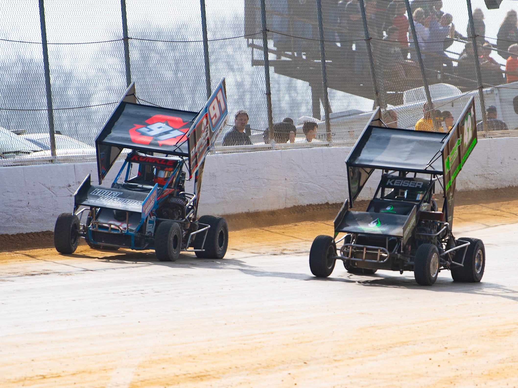 Randy Kunkle Jr. (92) and Travis Keiser (42K) are neck and neck during the Trail-Way Speedway season opener, April 6, 2019.