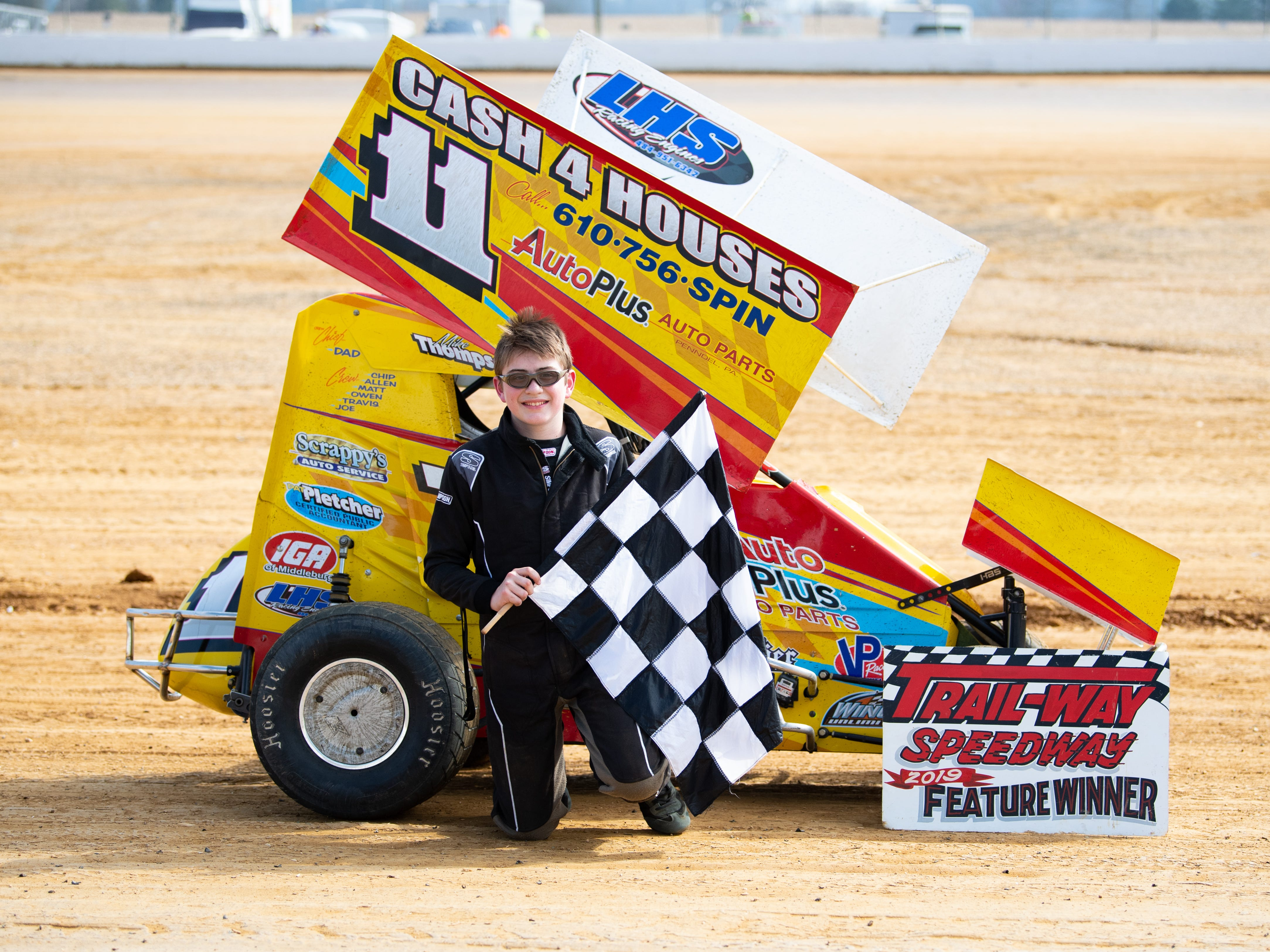 Michael Thompson (11) poses after winning his heat in the 600 Micro Sprints during the Trail-Way Speedway season opener, April 6, 2019.