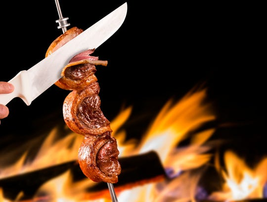At Churrasco Brazilian Steakhouse, ahead in downtown Reno, meats (like this picanha sirloin cap) are sliced at table from skewers.