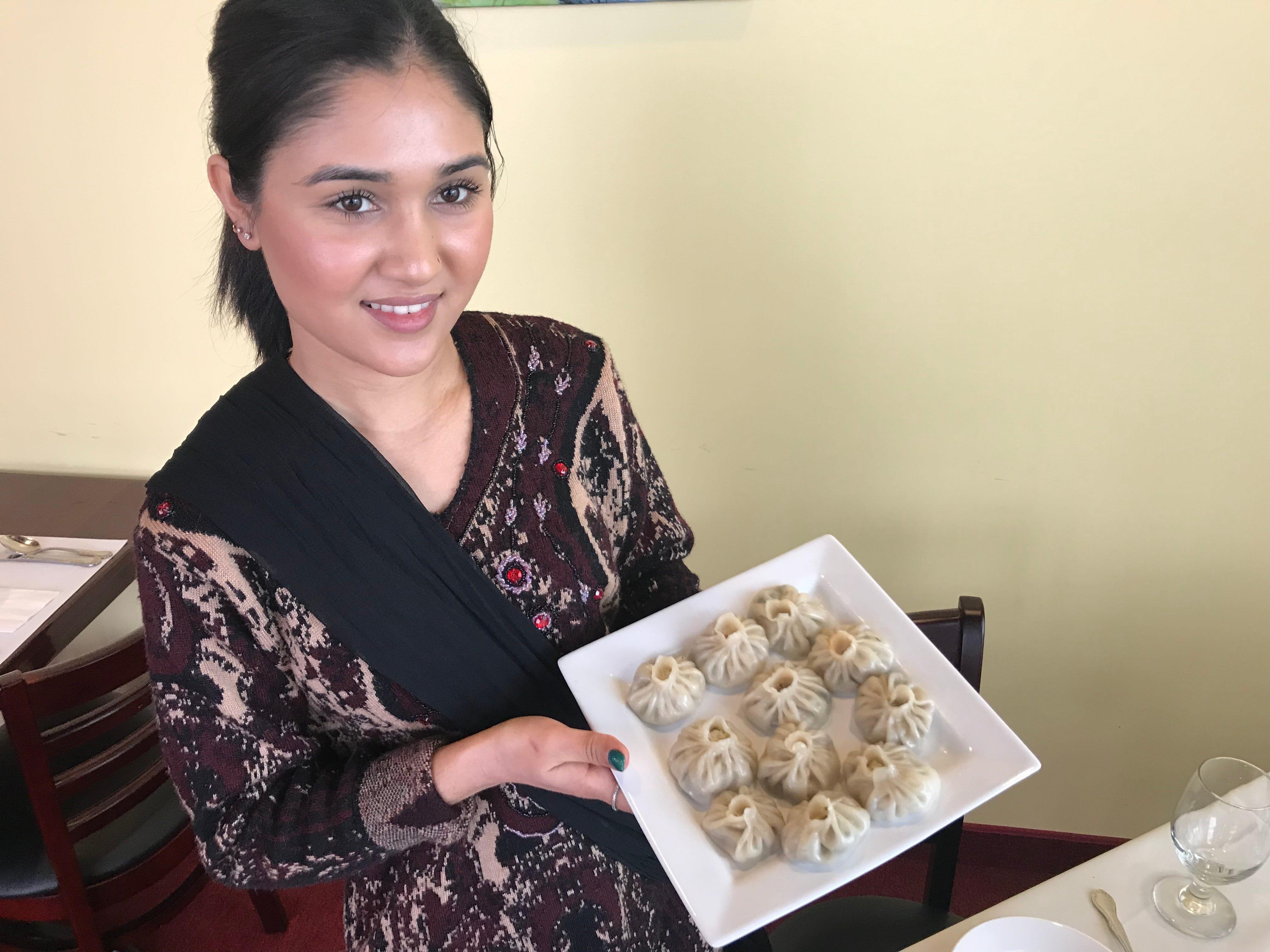 Anisha Chuhan prepares hand-made dumplings called momos at Royal of India.