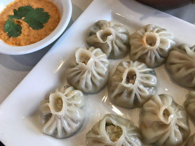 Momos are dumplings served during celebrations in Nepal.