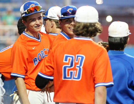 The San Angelo Central Bobcats share a laugh during a game earlier in the 2019 baseball season.