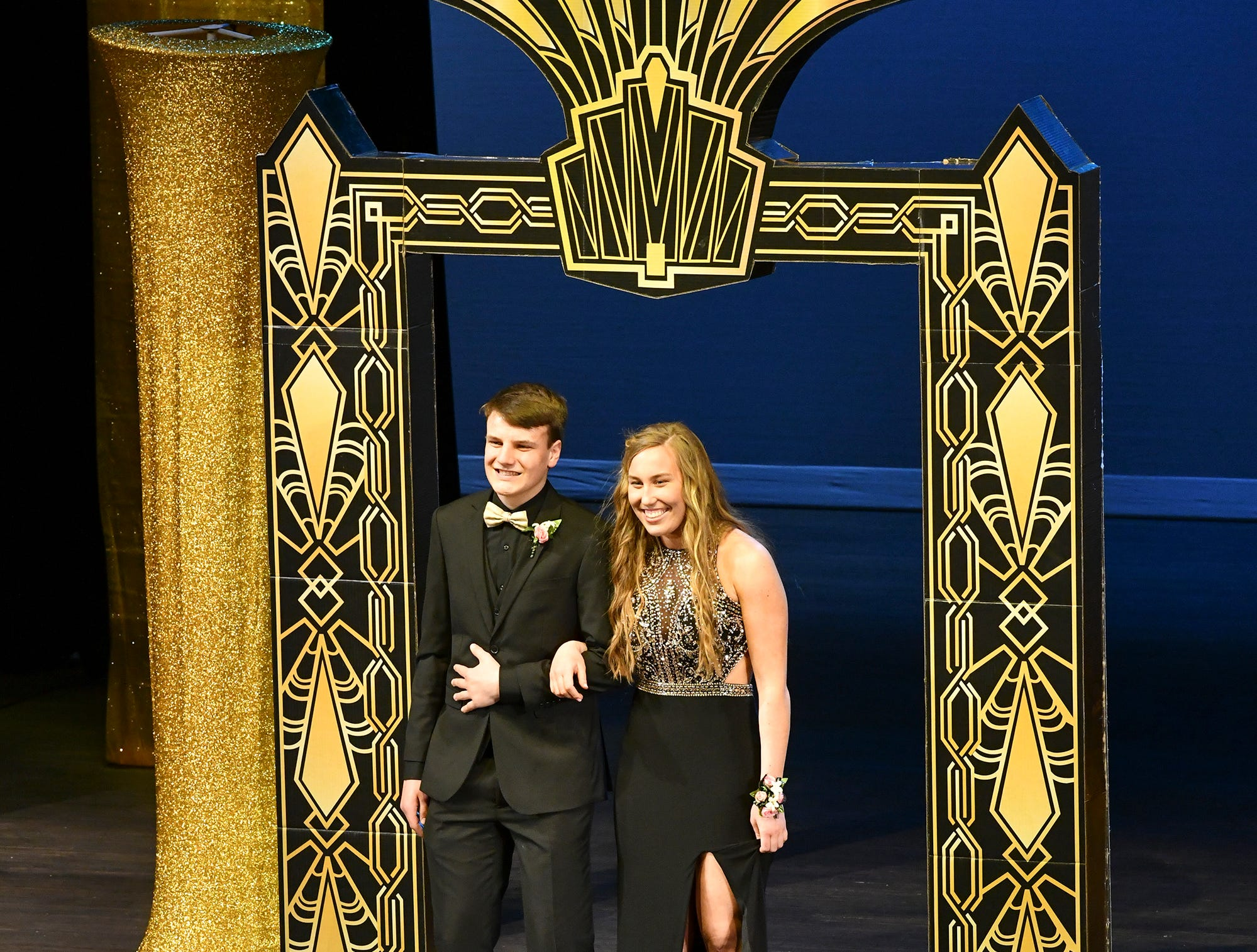 Abby Davey and Jacob Burg take their turn on stage during prom grand march Saturday, April 6, at Albany High School.
