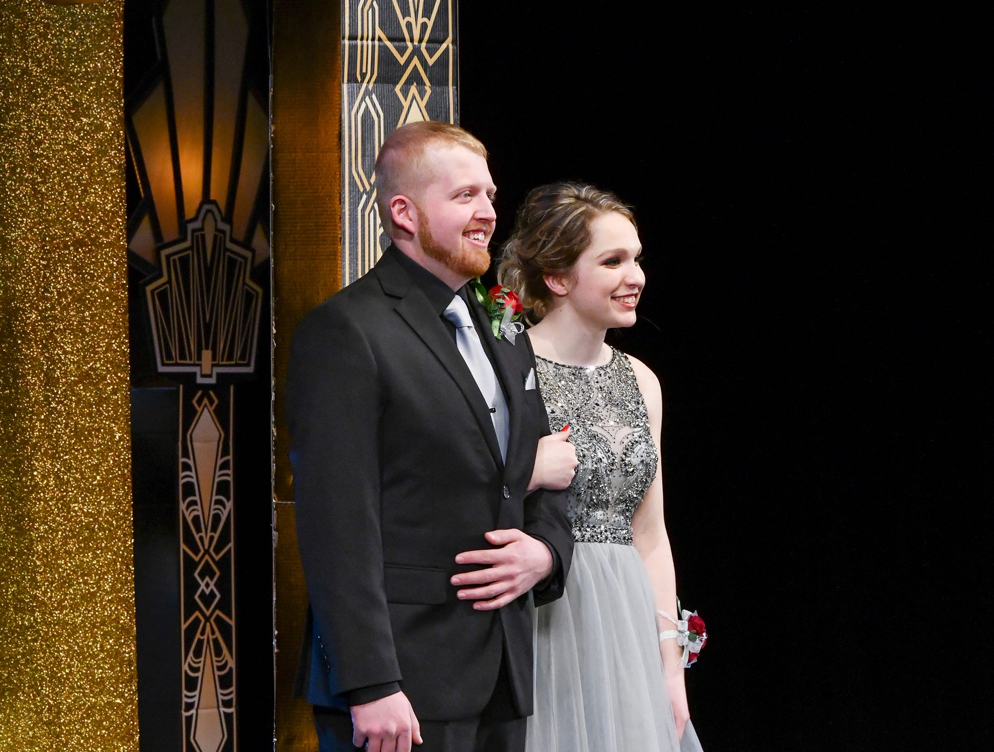 Megan Martini and Mitchell Klaphake smile during prom grand march Saturday, April 6, at Albany High School.
