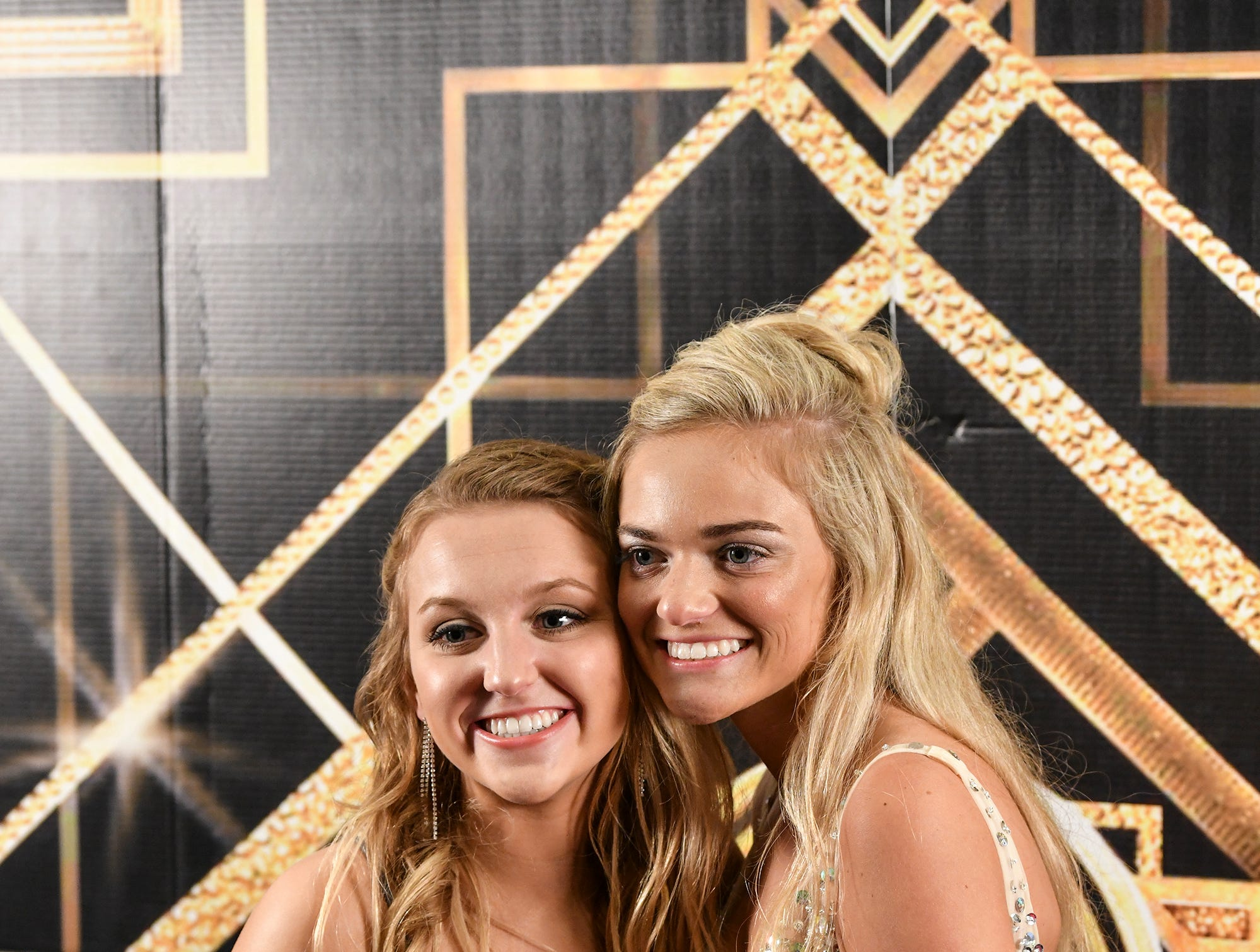 Kiley Kotzer and Brooke Schleicher pose for a photograph before the start of prom grand march Saturday, April 6, at Albany High School.