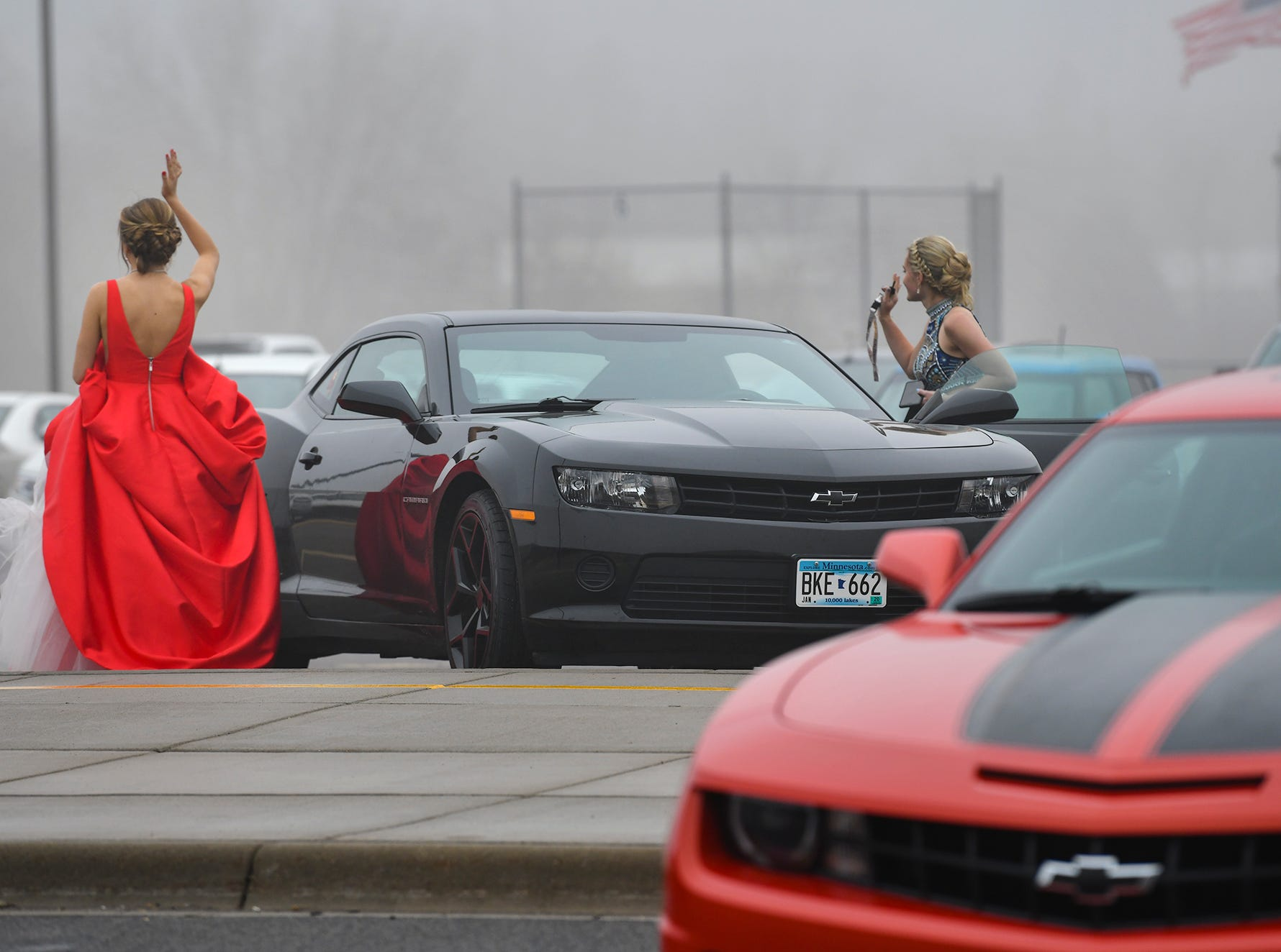 Promgoers wave to their friends following prom grand march Saturday, April 6, at Albany High School.
