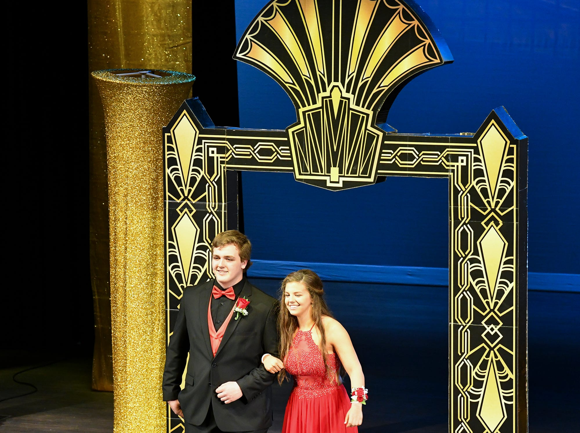 Olivia Haakonson and Devin Ritter take their turn on stage during prom grand march Saturday, April 6, at Albany High School.