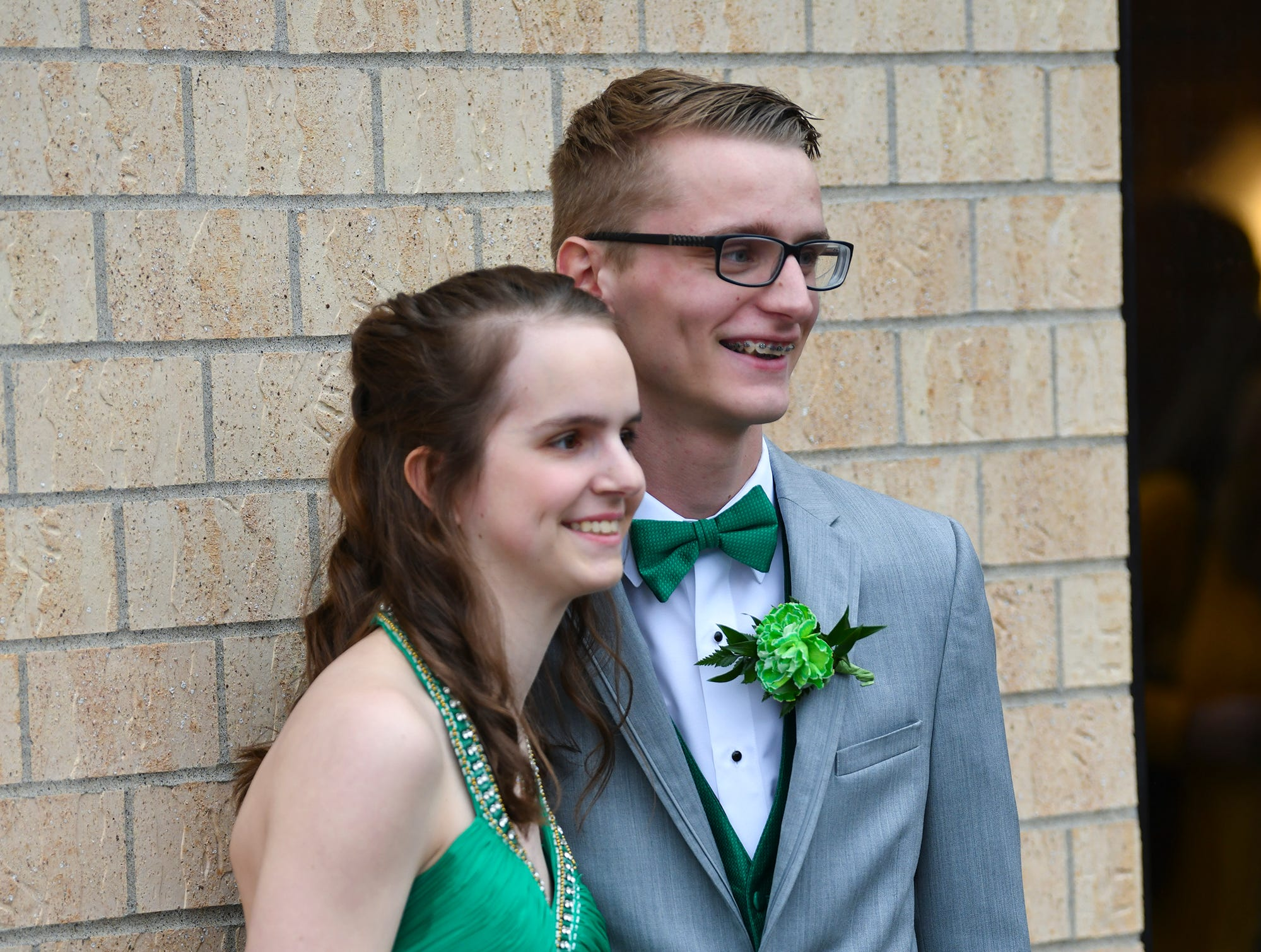 Becca Ostendorf and Logan Winter pose for photos following prom grand march Saturday, April 6, at Albany High School.
