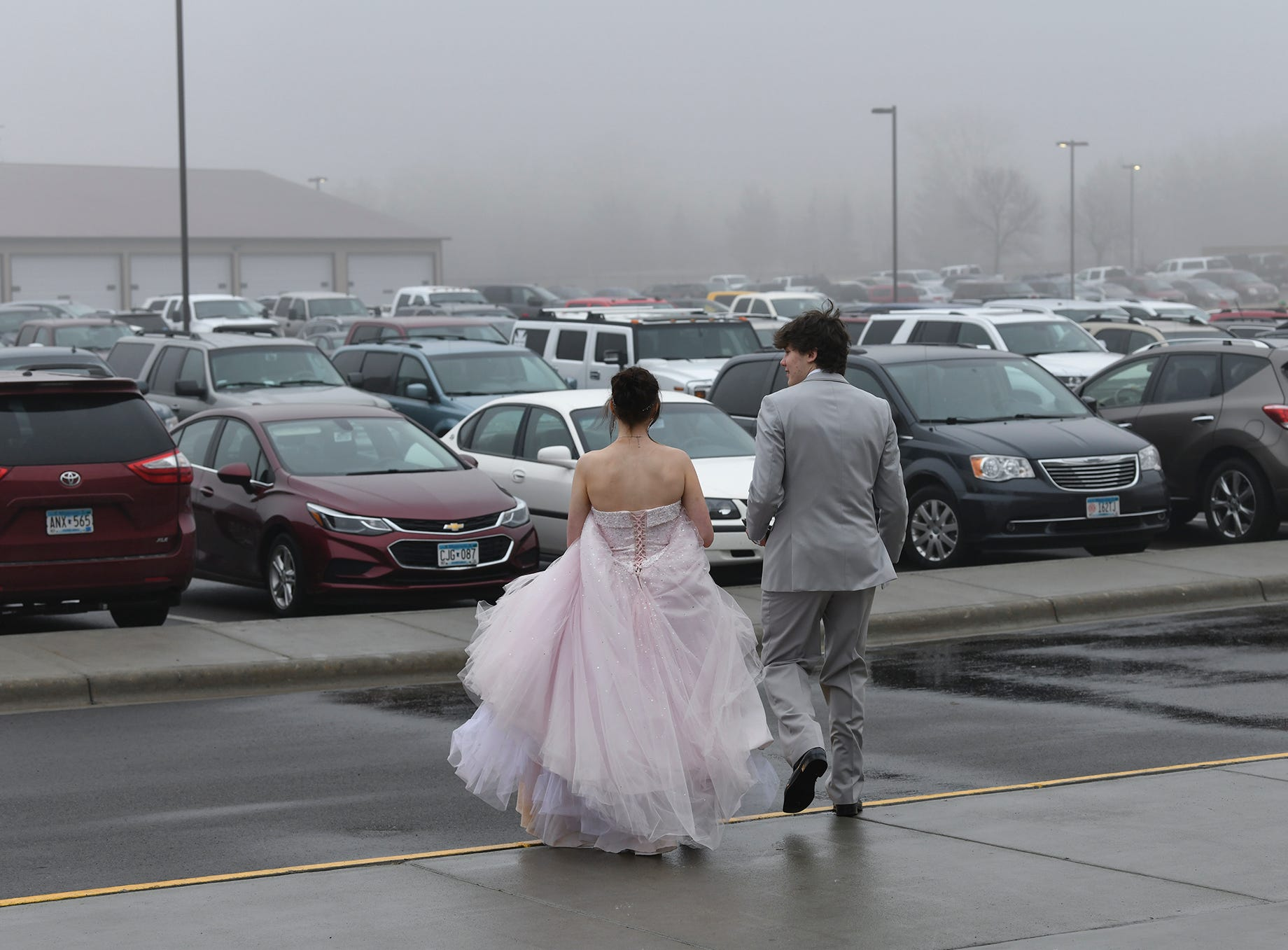 Couples leave following prom grand march Saturday, April 6, at Albany High School.