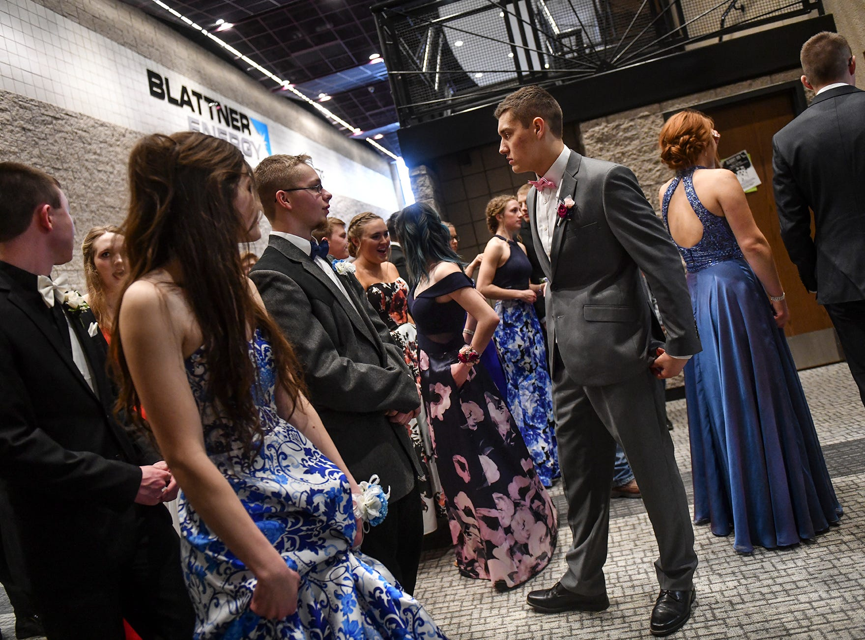 Couples get ready to take the stage for prom grand march Saturday, April 6, at Albany High School.