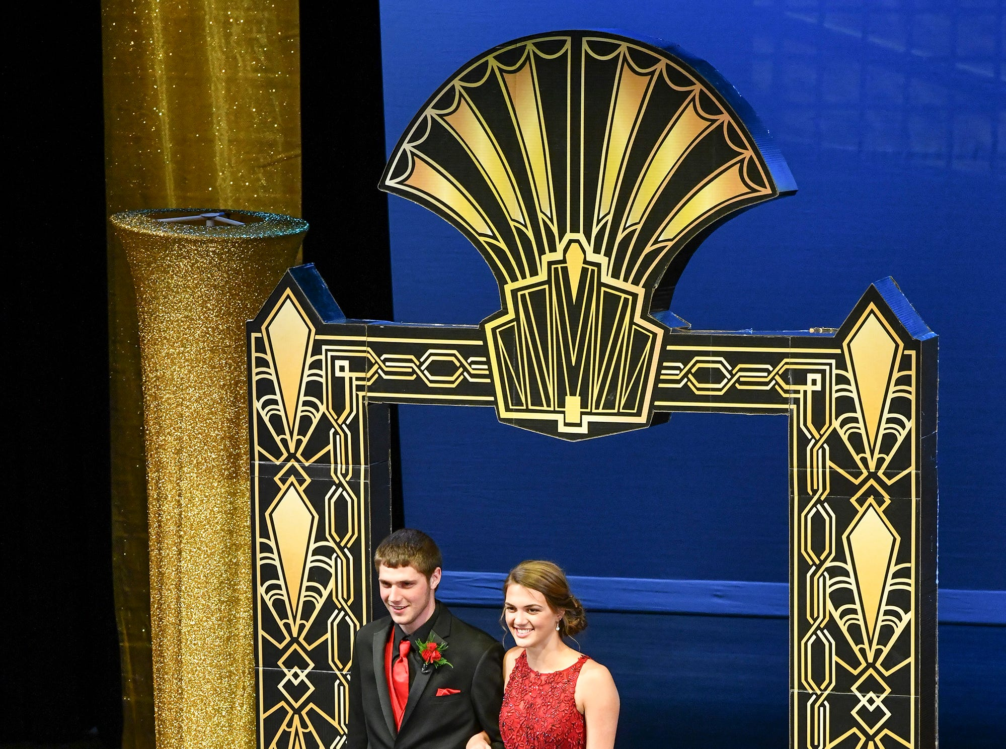 Crystal Koglin and Logan Arceneau smile during prom grand march Saturday, April 6, at Albany High School.