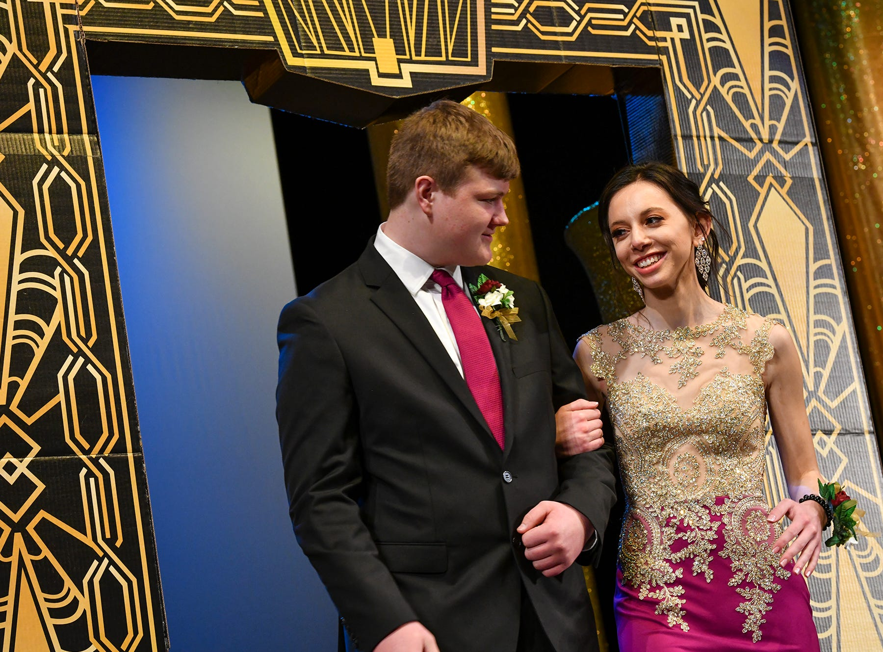 Jamie Dubbin and Travis Boyer smile during prom grand march Saturday, April 6, at Albany High School.