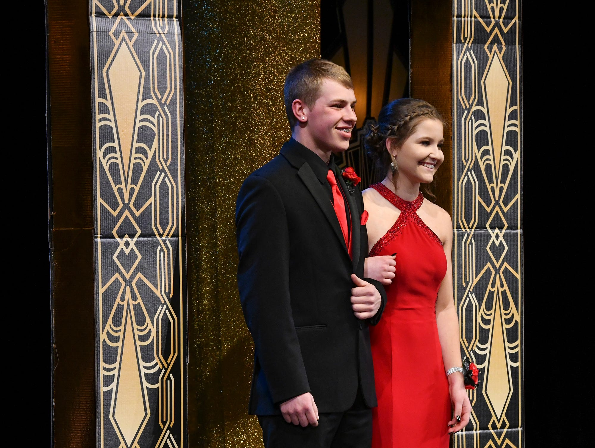 Mya Snyder and Jacob Gilk smile on stage during prom grand march Saturday, April 6, at Albany High School.