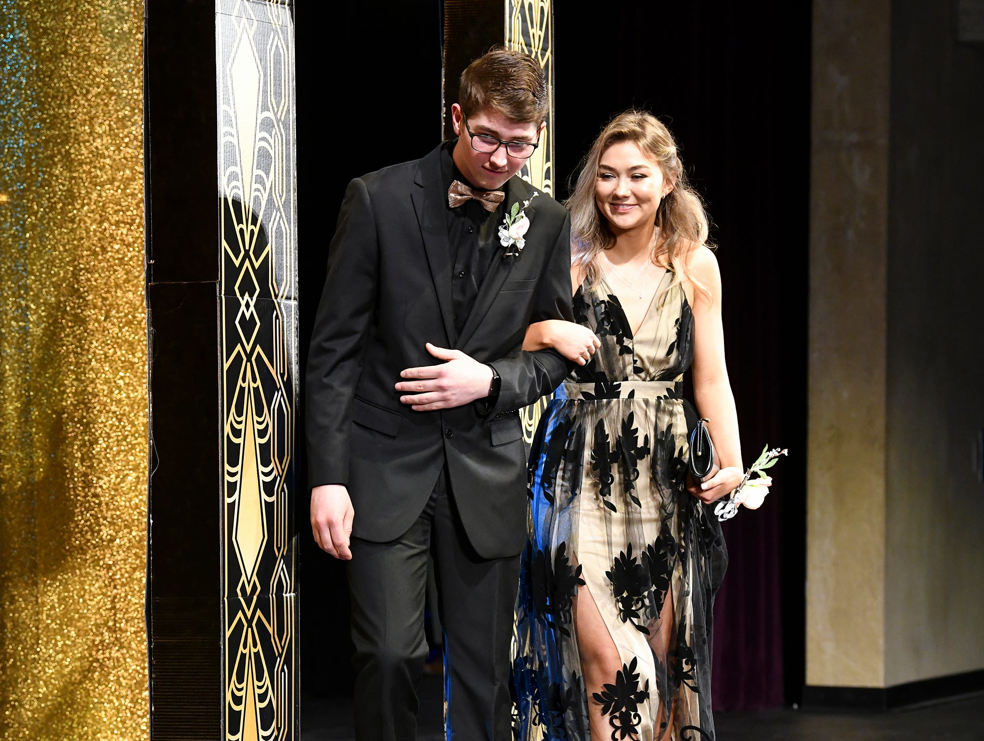 Ashley Kashevaroff and Andrew Norris take their turn during prom grand march Saturday, April 6, at Albany High School.