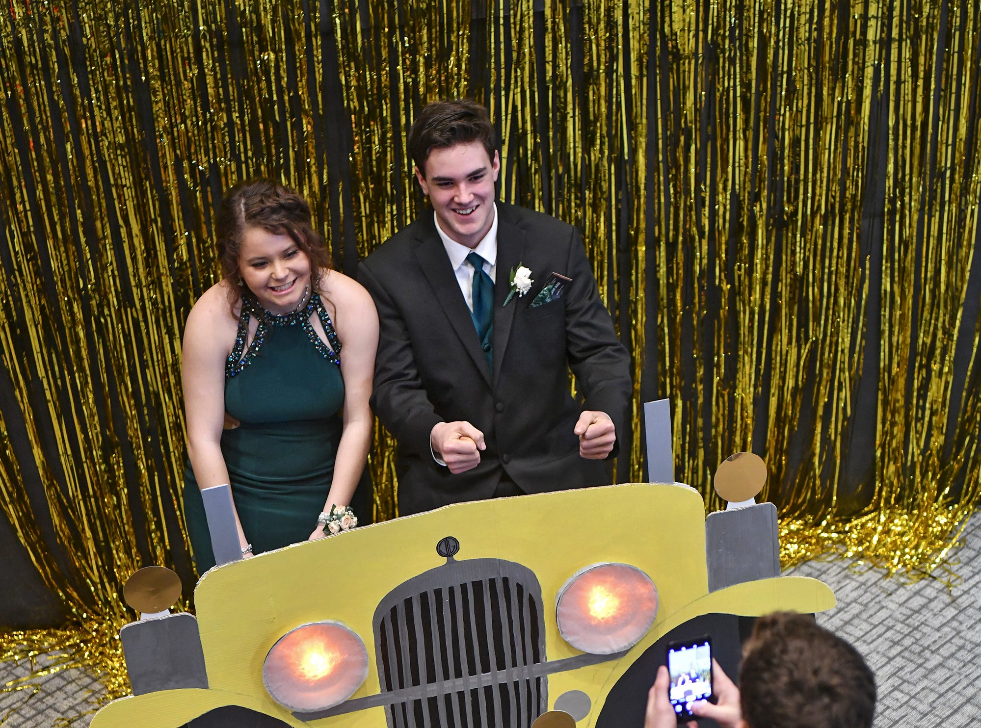 Couples pose for photographs during prom Saturday, April 6, at Albany High School.