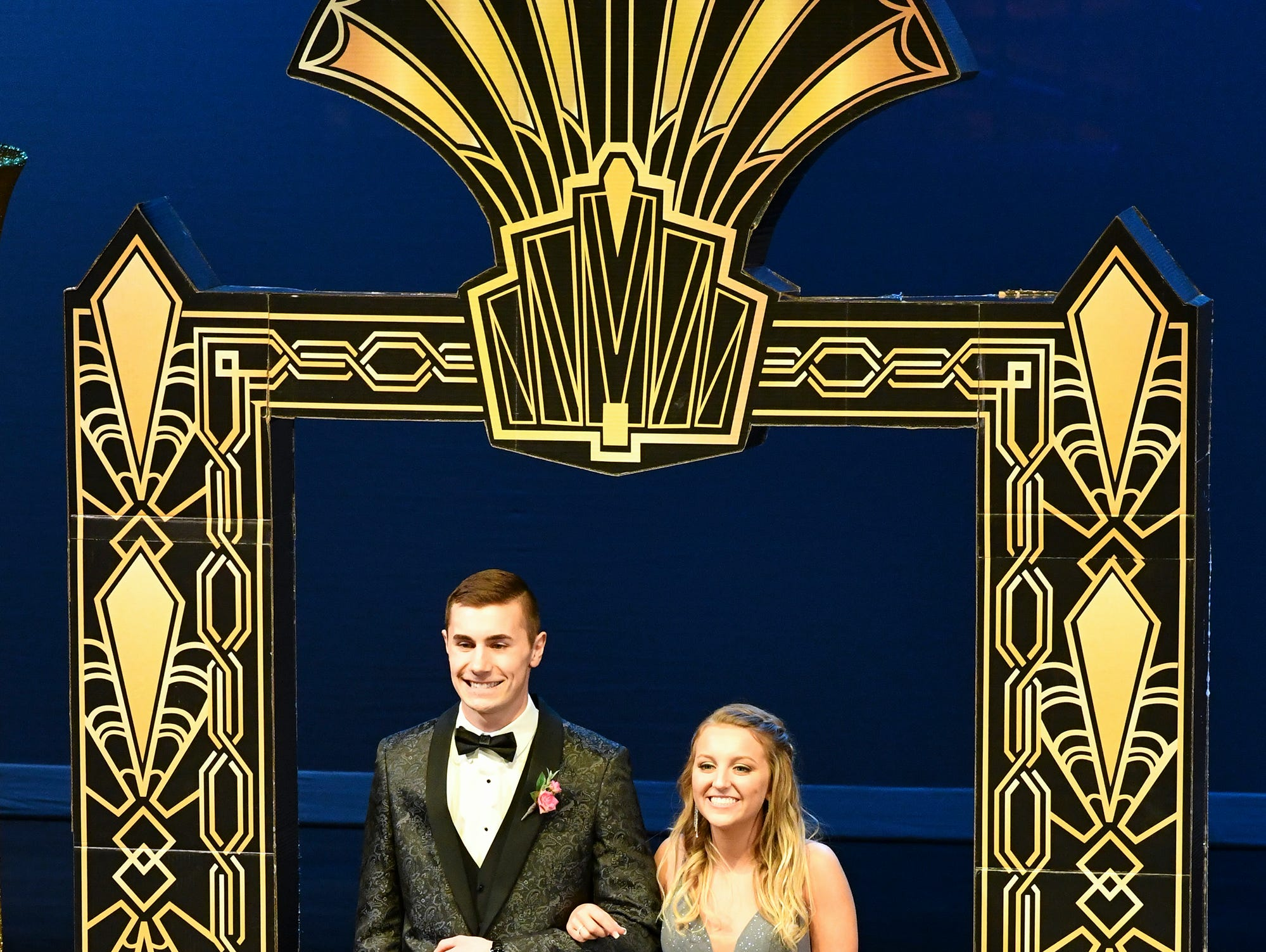 Kiley Kotzer and Ben Buttweiler smile during prom grand march Saturday, April 6, at Albany High School.