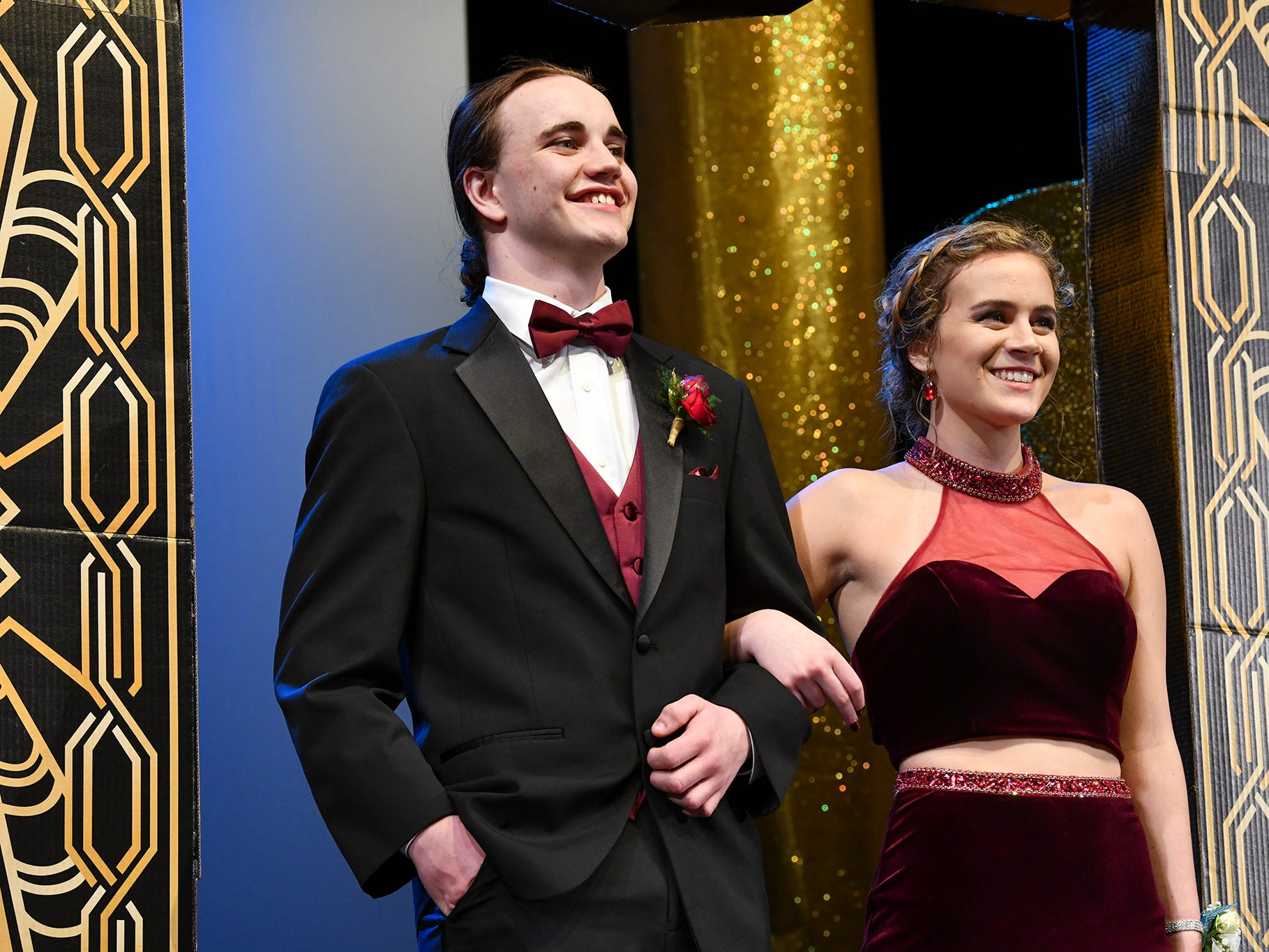 Kendra Bromenschenkel and Steven Davis smile during prom grand march Saturday, April 6, at Albany High School.