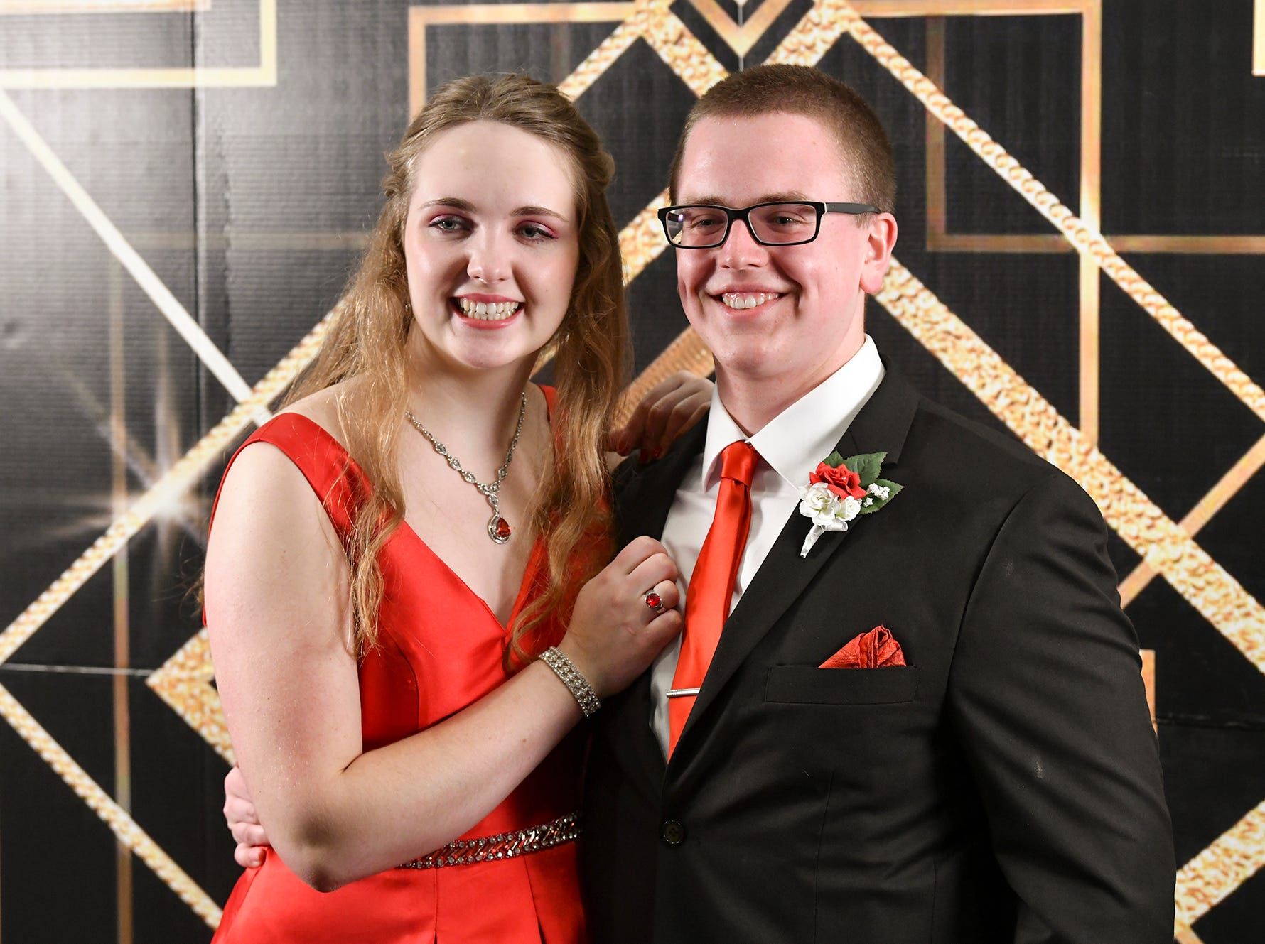 Alexis Studinski and Josh Killmer pose for a photograph on a Great Gatsby-themed backround before the start of prom grand march Saturday, April 6, at Albany High School.