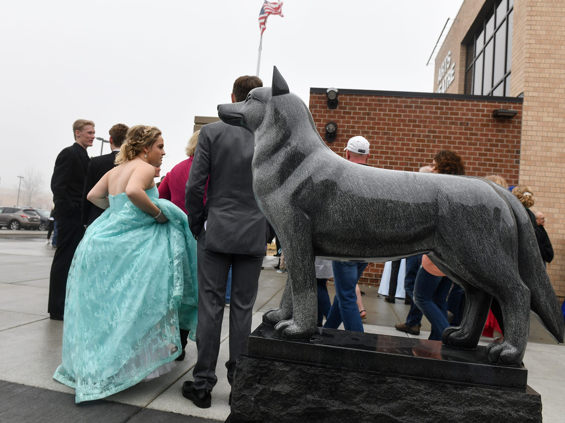 Couples gather outside the theatre following prom grand march Saturday, April 6, at Albany High School.