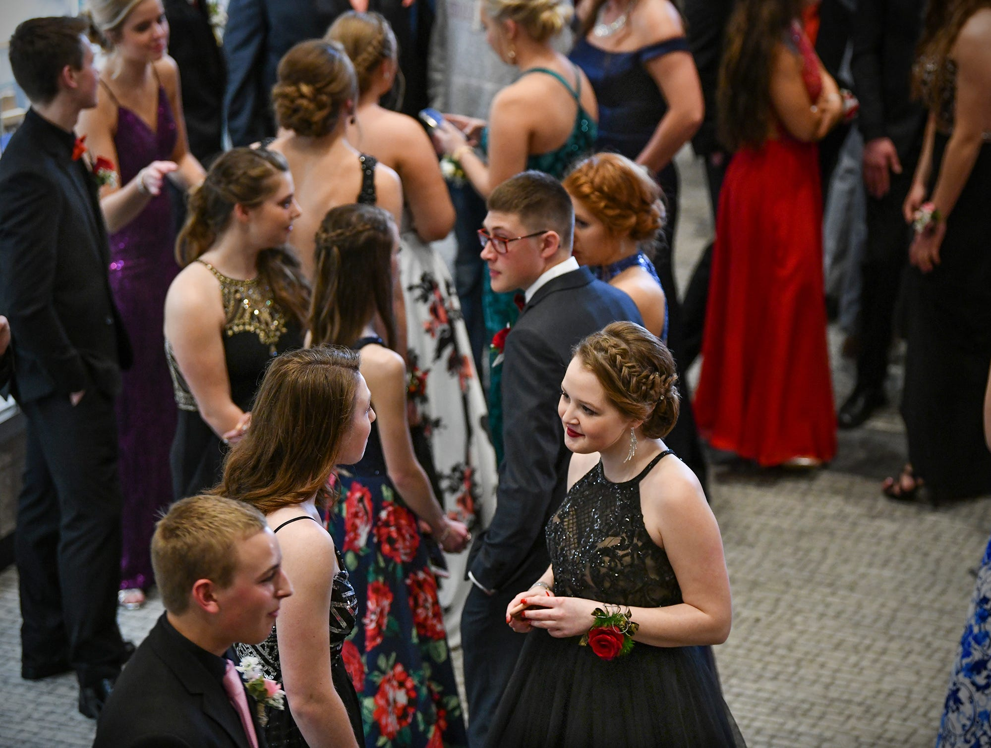 Couples wait their turn for prom grand march Saturday, April 6, at Albany High School.