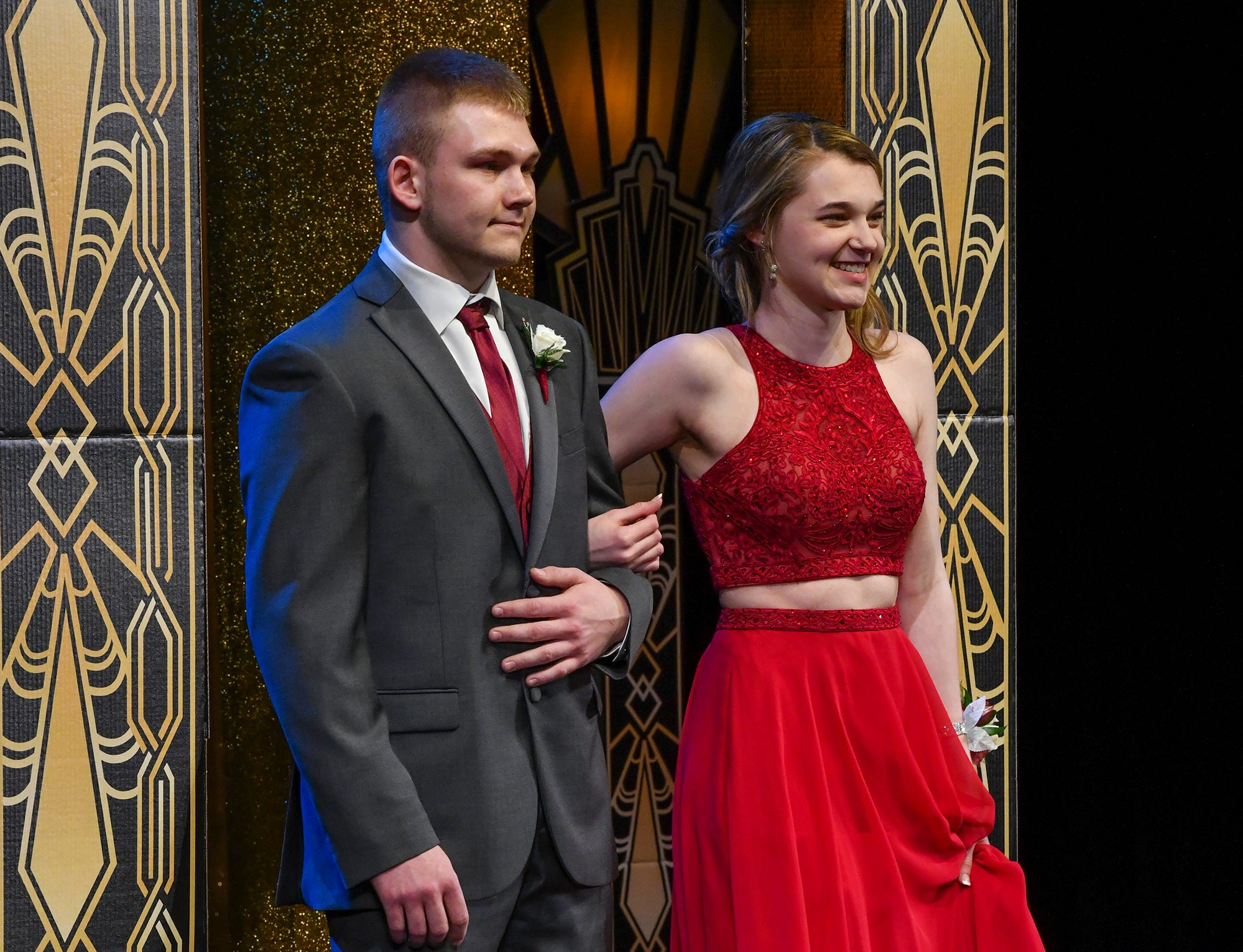 Paige Mead and Riley Rakotz take the stage during prom grand march Saturday, April 6, at Albany High School.