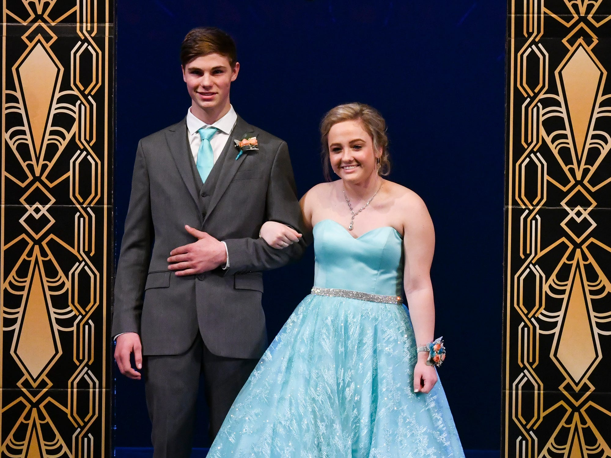 Brianna Helton and Peyton Linn take their turn during prom grand march Saturday, April 6, at Albany High School.