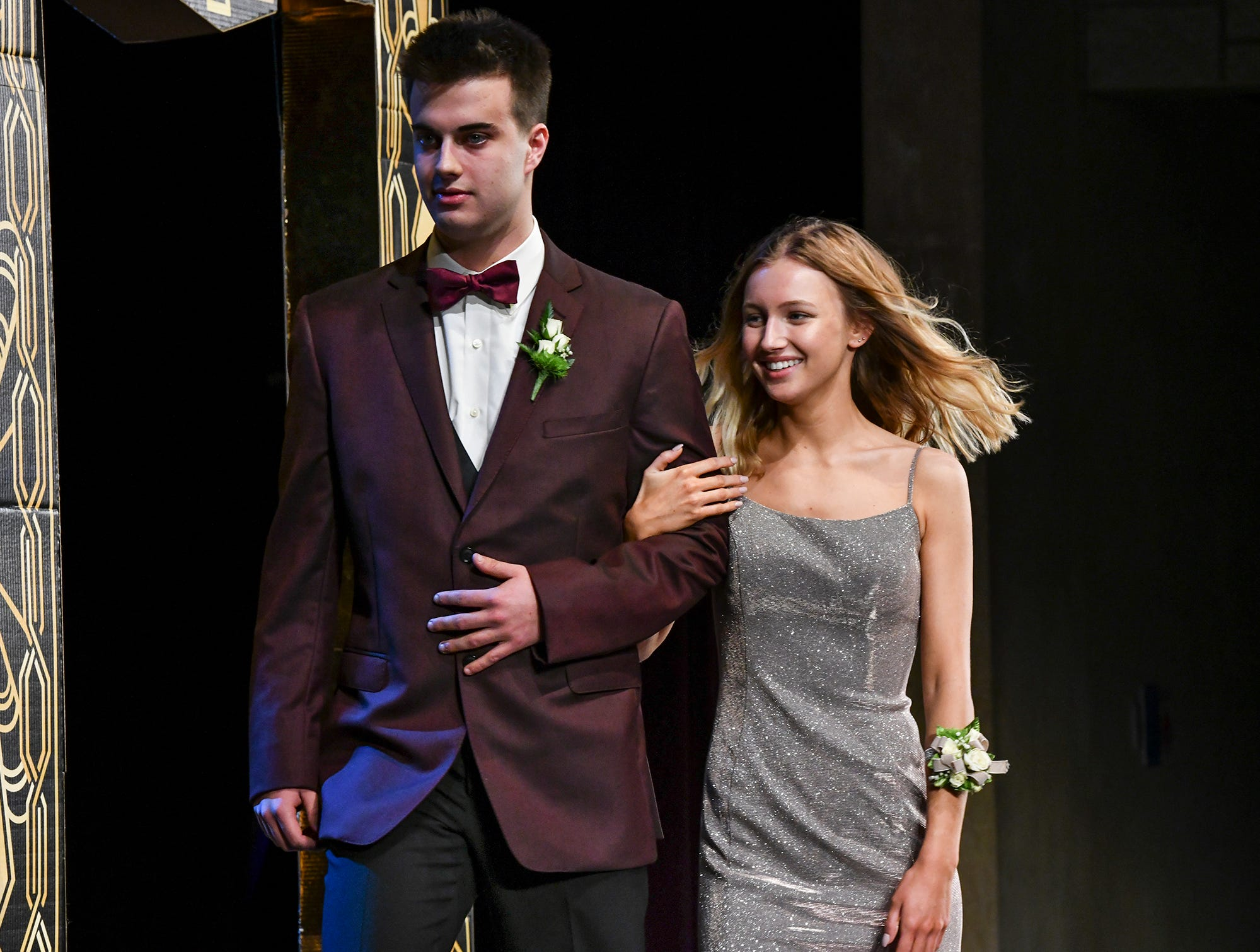 Kendall Schmitt and John Davis leave the stage after their turn during prom grand march Saturday, April 6, at Albany High School.