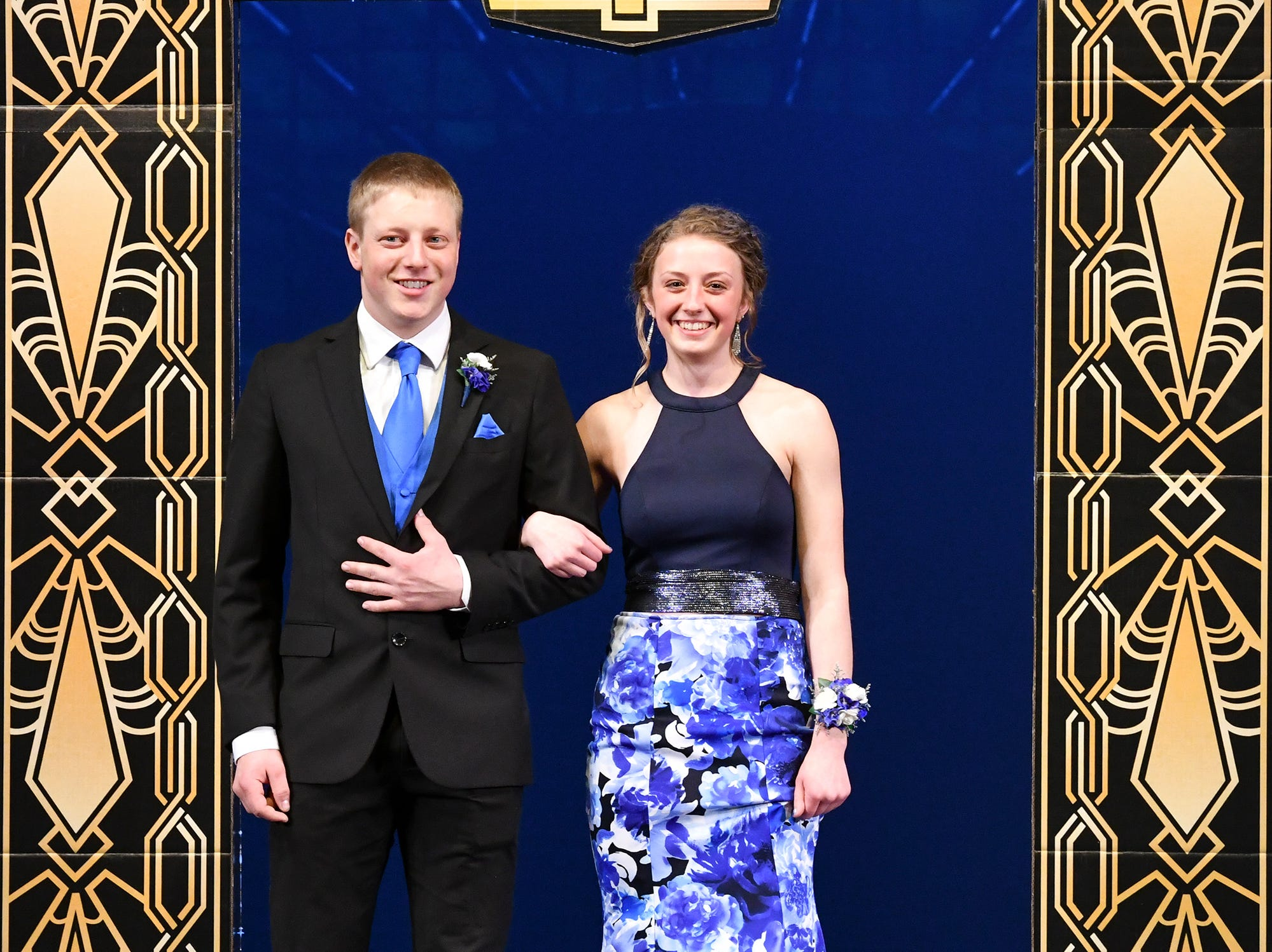 Sophia Waletzko and Derek Kulzer smile during prom grand march Saturday, April 6, at Albany High School.