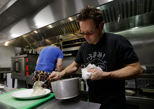 Christian Czerwonka prepares a dish on Saturday, April 6, 2019, at Chef's Kitchen in Stevens Point, Wis. The restaurant, owned by Czerwonka and his wife, Leah, features a fluid culinary theme to keep things fresh for both themselves and their customers.