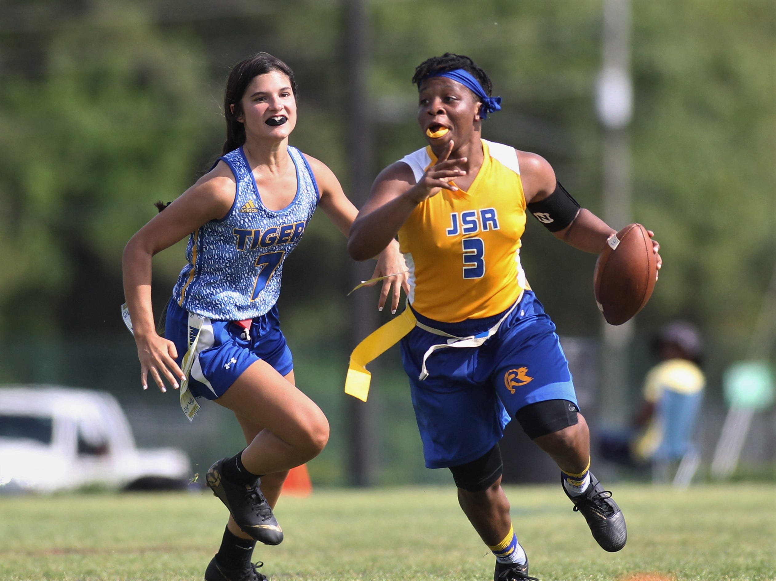 Rickards quarterback Iyanla Woofaulk escapes the pocket against Martin County during in the 2019 Capital City Classic flag football tournament at the FSU Rec SportsPlex on April 6, 2019.